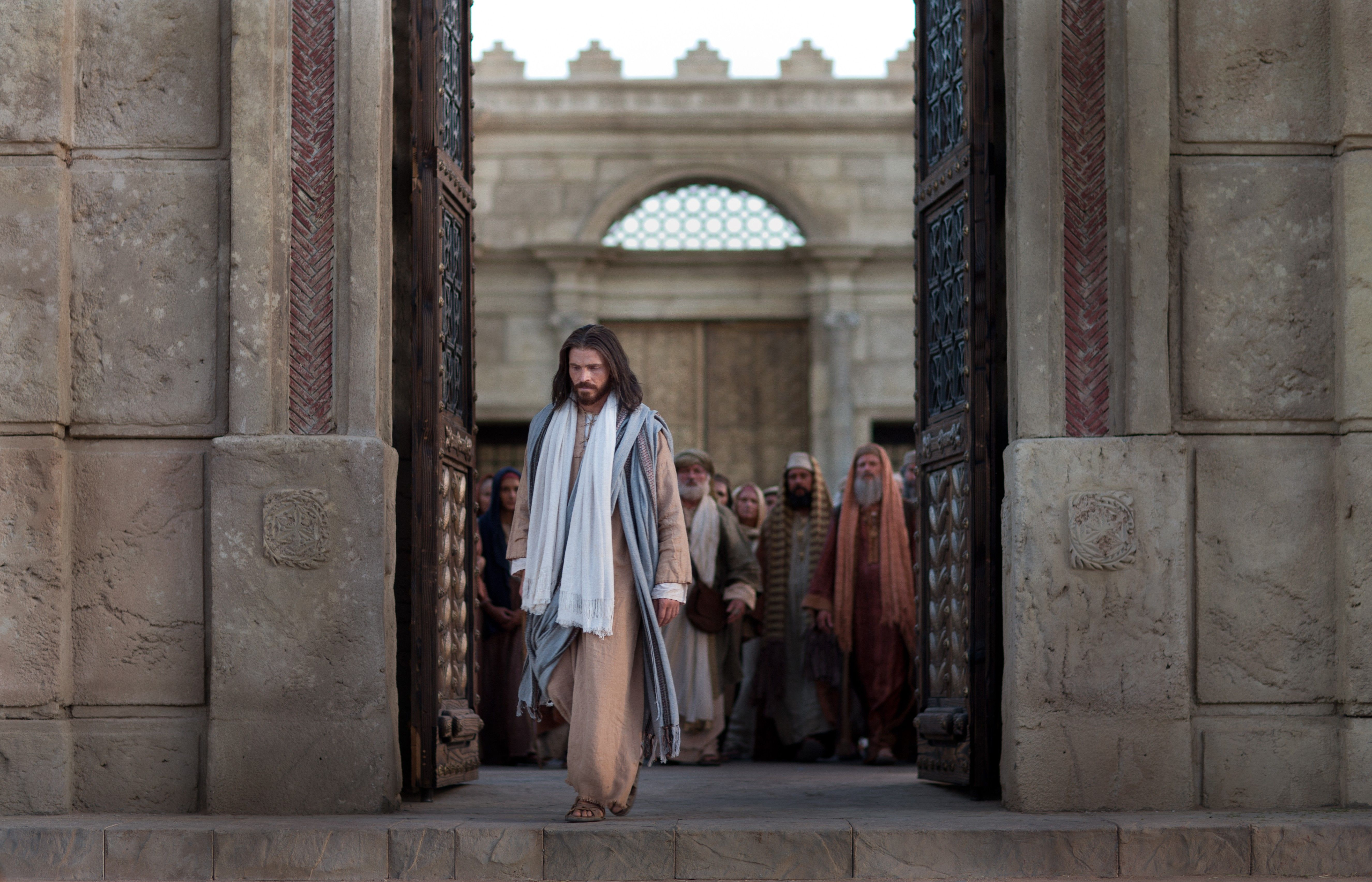 Jesus exits the temple as Pharisees question Him.