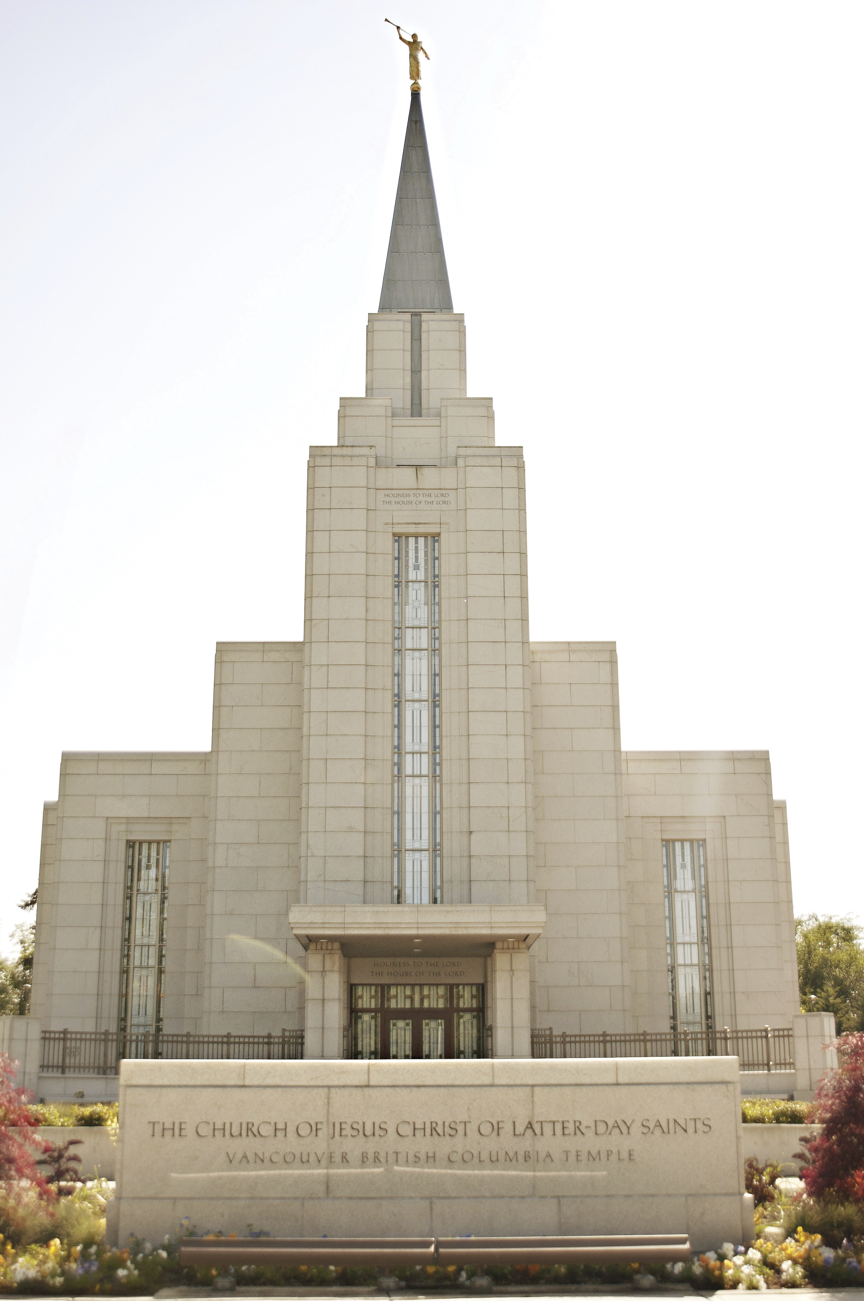 The entire Vancouver British Columbia Temple, with the name sign, entrance, windows, and spire.