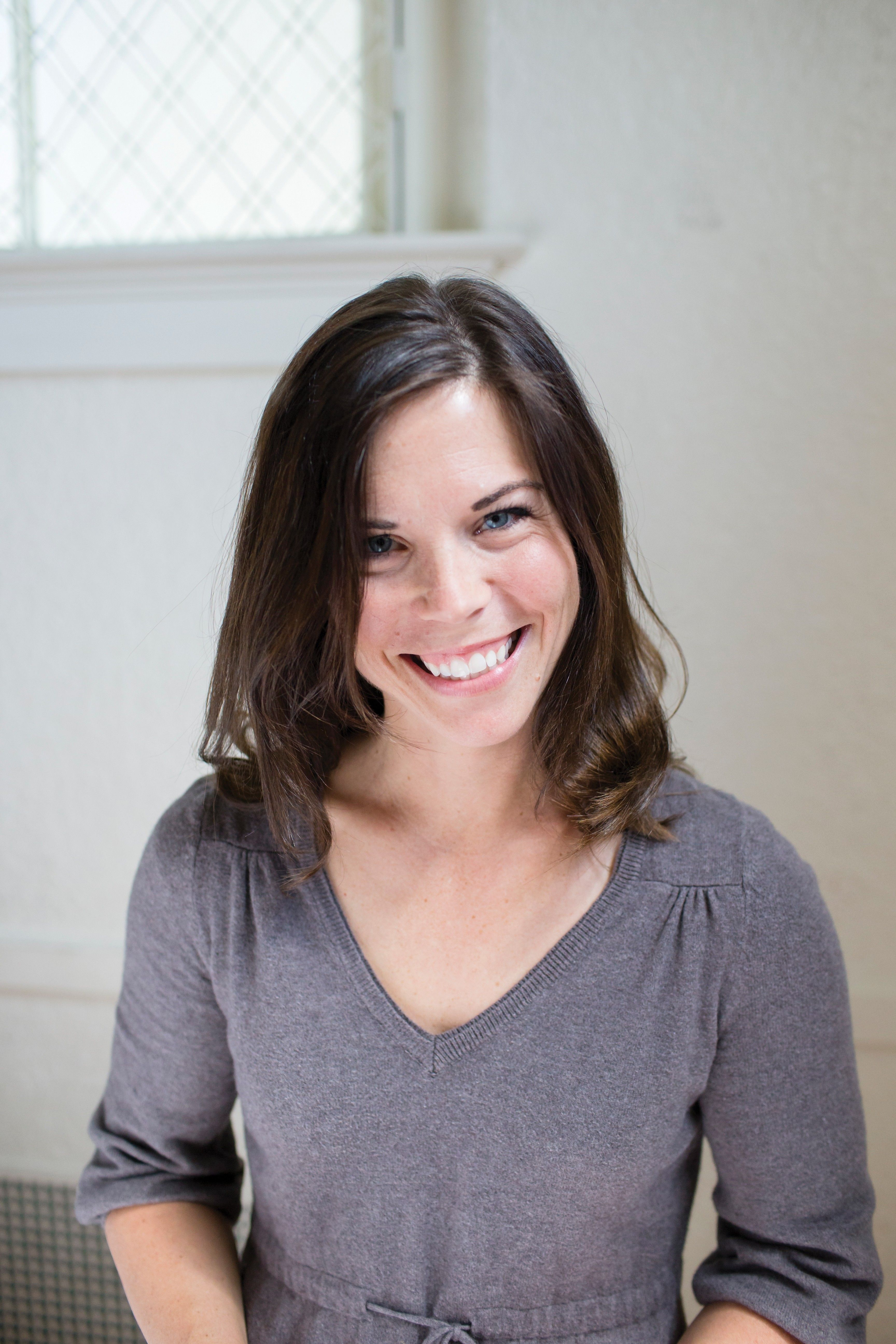 A portrait of a woman smiling.