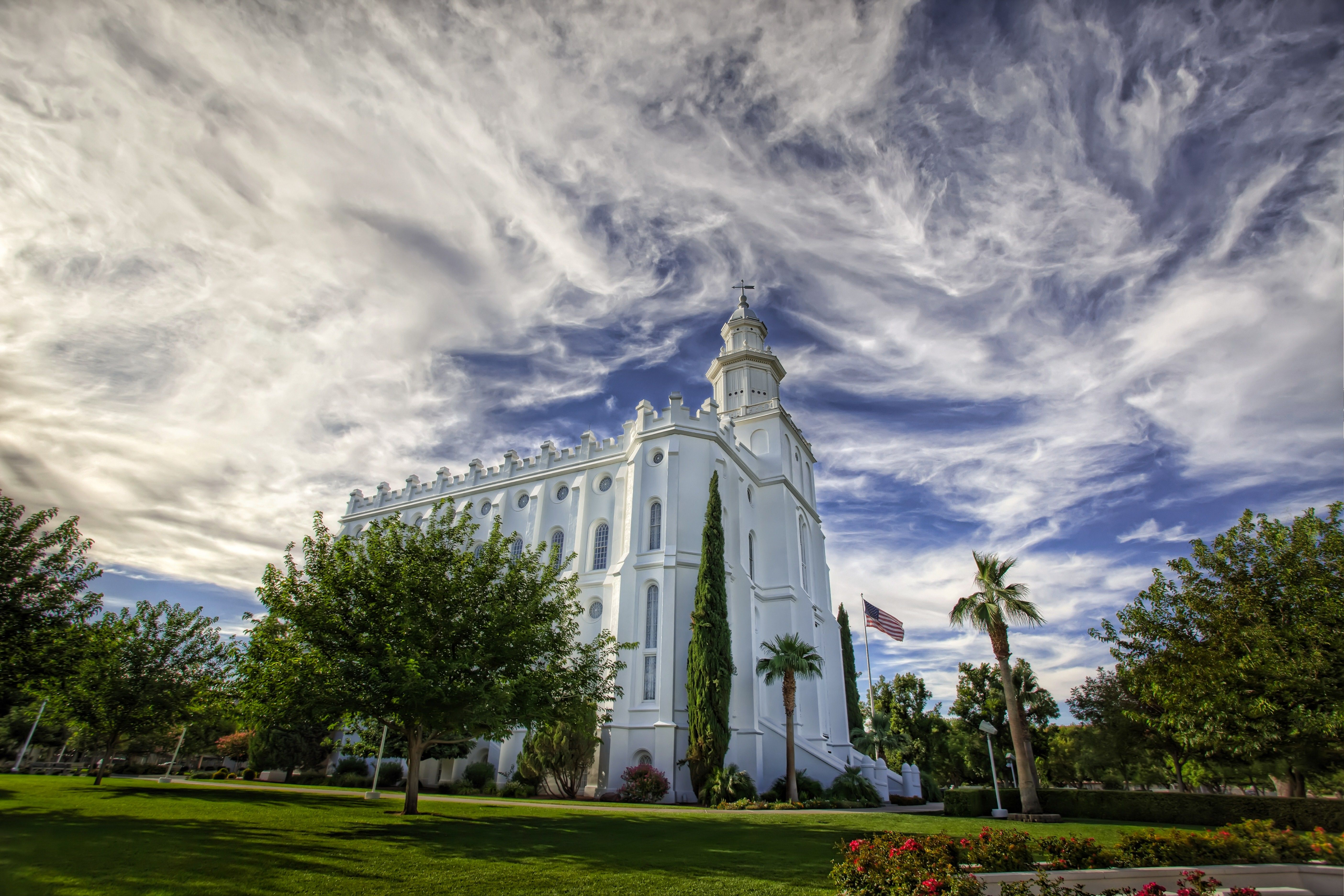The St. George Utah Temple in daylight, including the entrance and scenery.