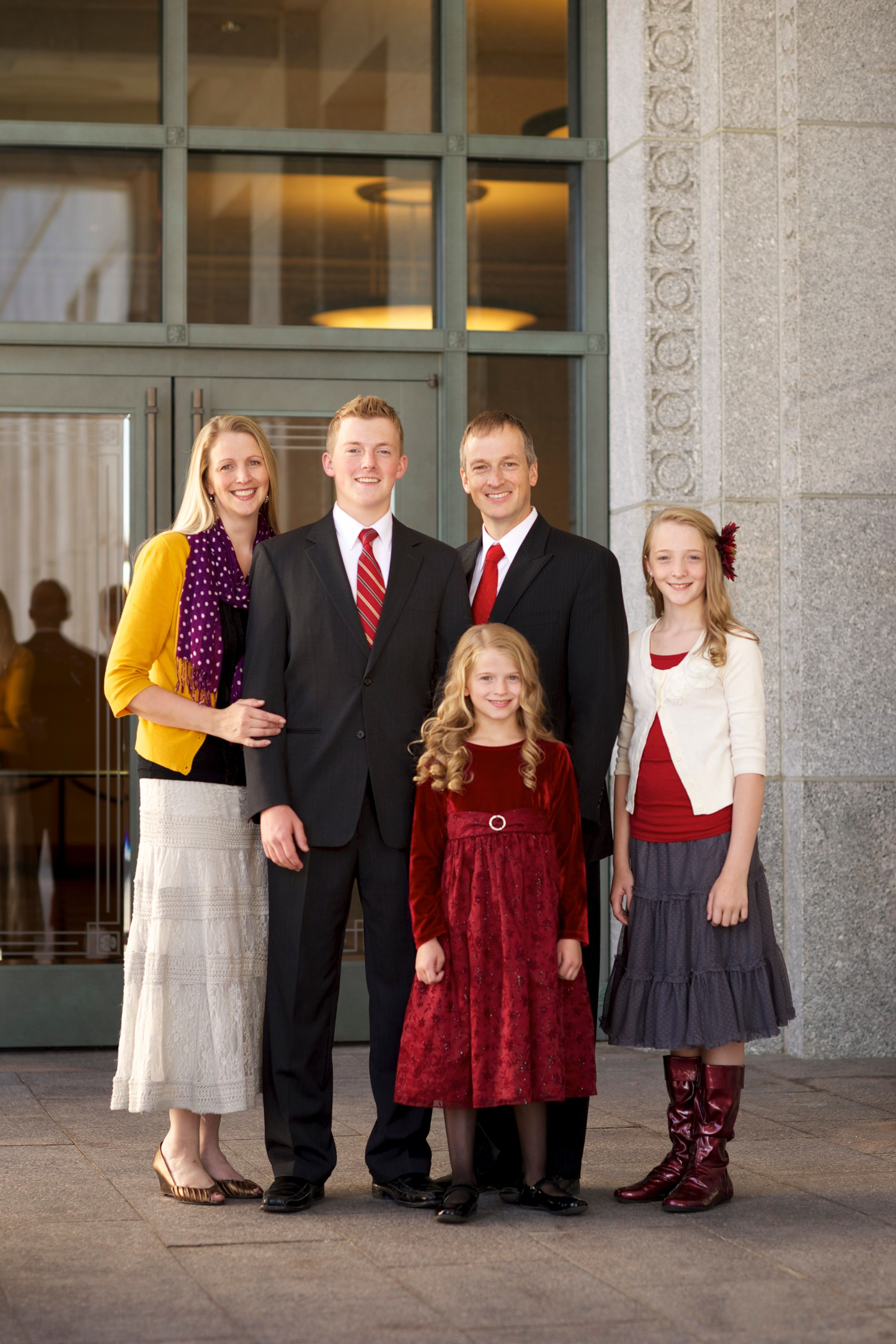 Two parents and their three children stand outside the doors of the Conference Center.