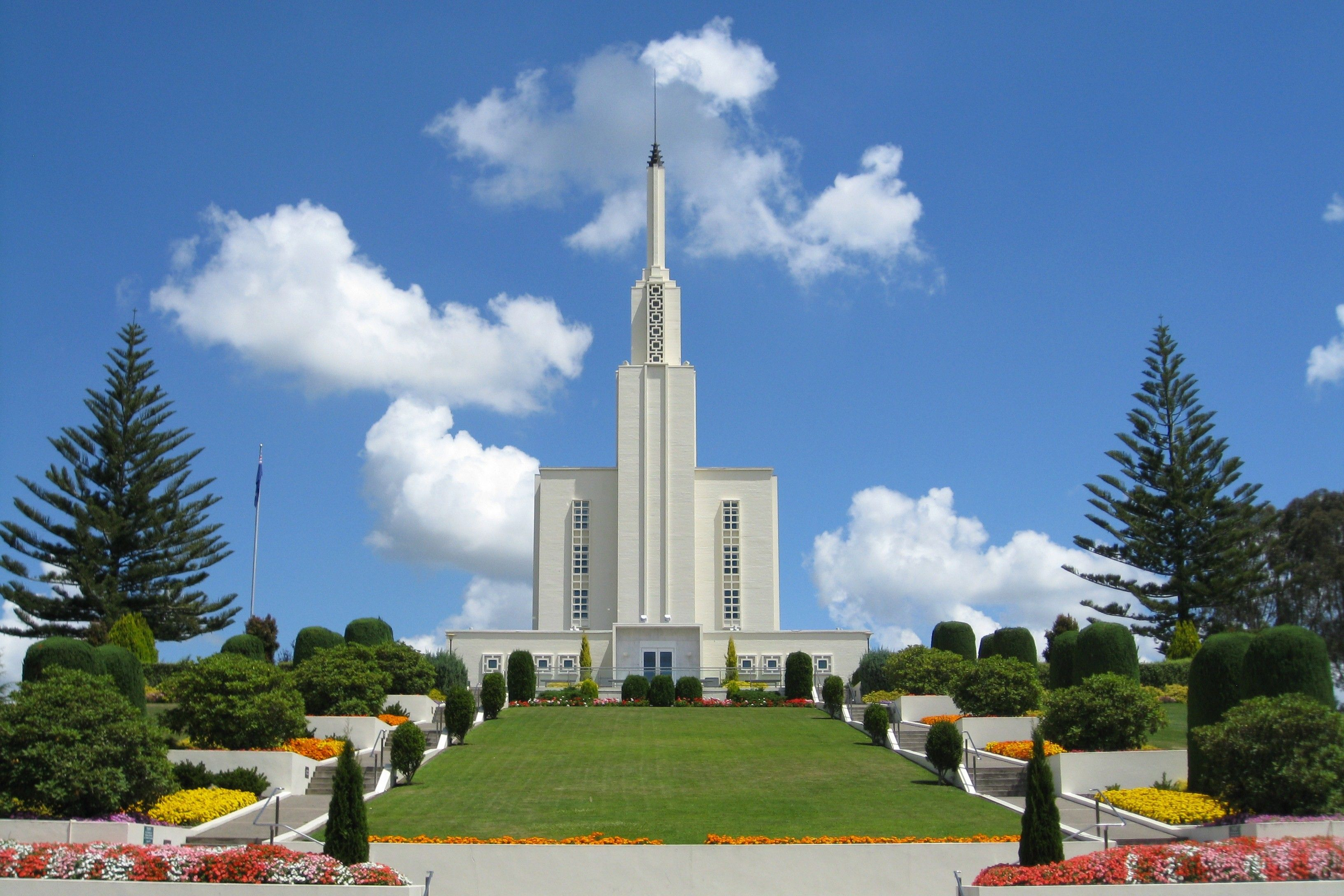 A view of the Hamilton New Zealand Temple and grounds during the day.