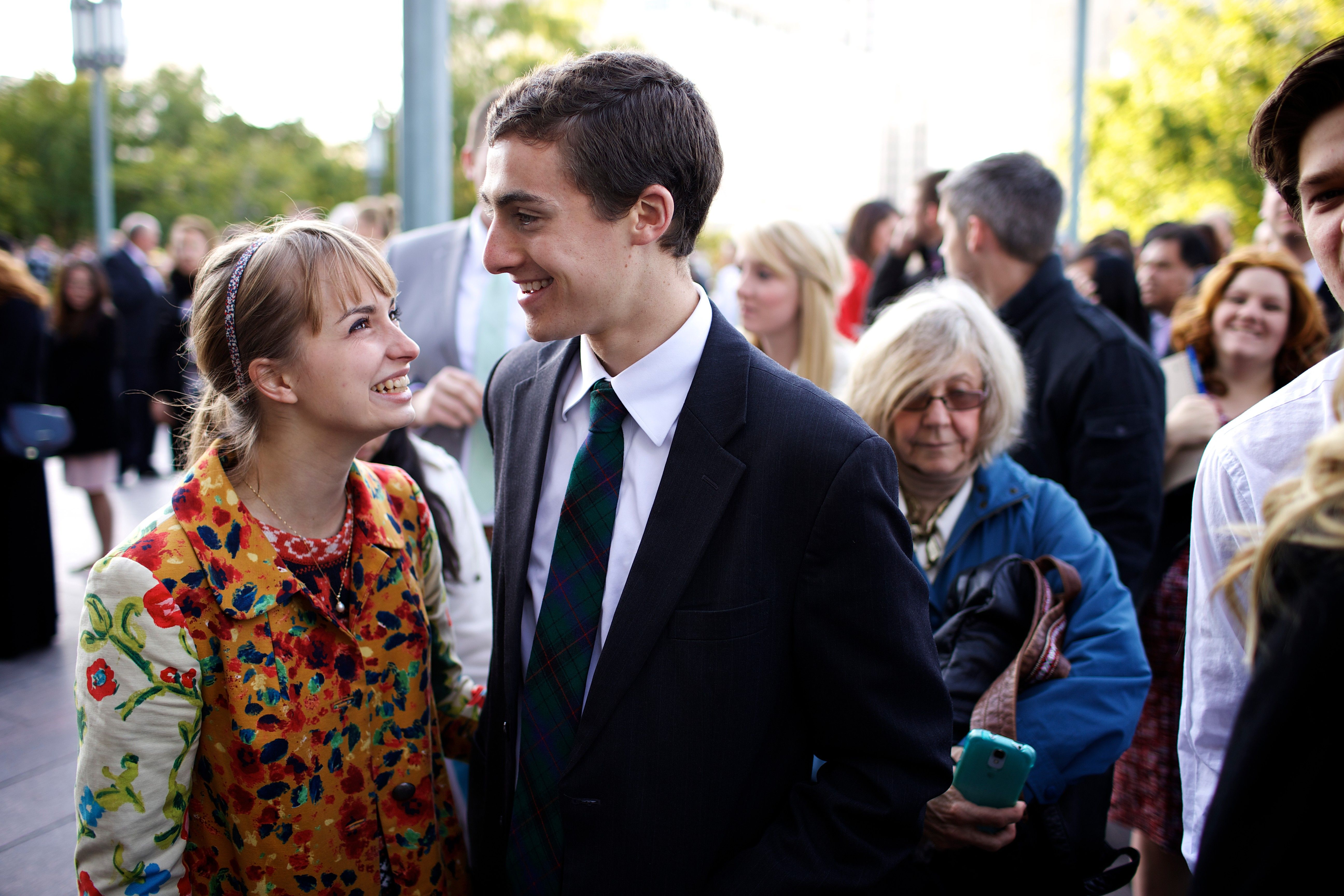 A young couple standing outside the Conference Center.