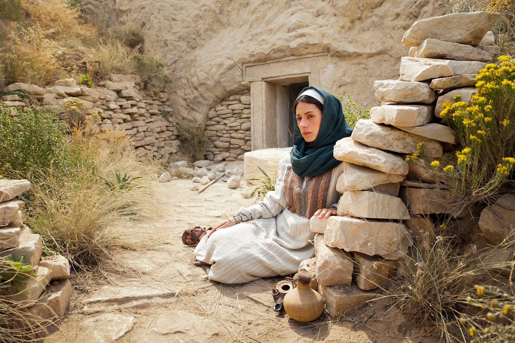 Mary Magdalene weeps after seeing that Christ's body is gone.
