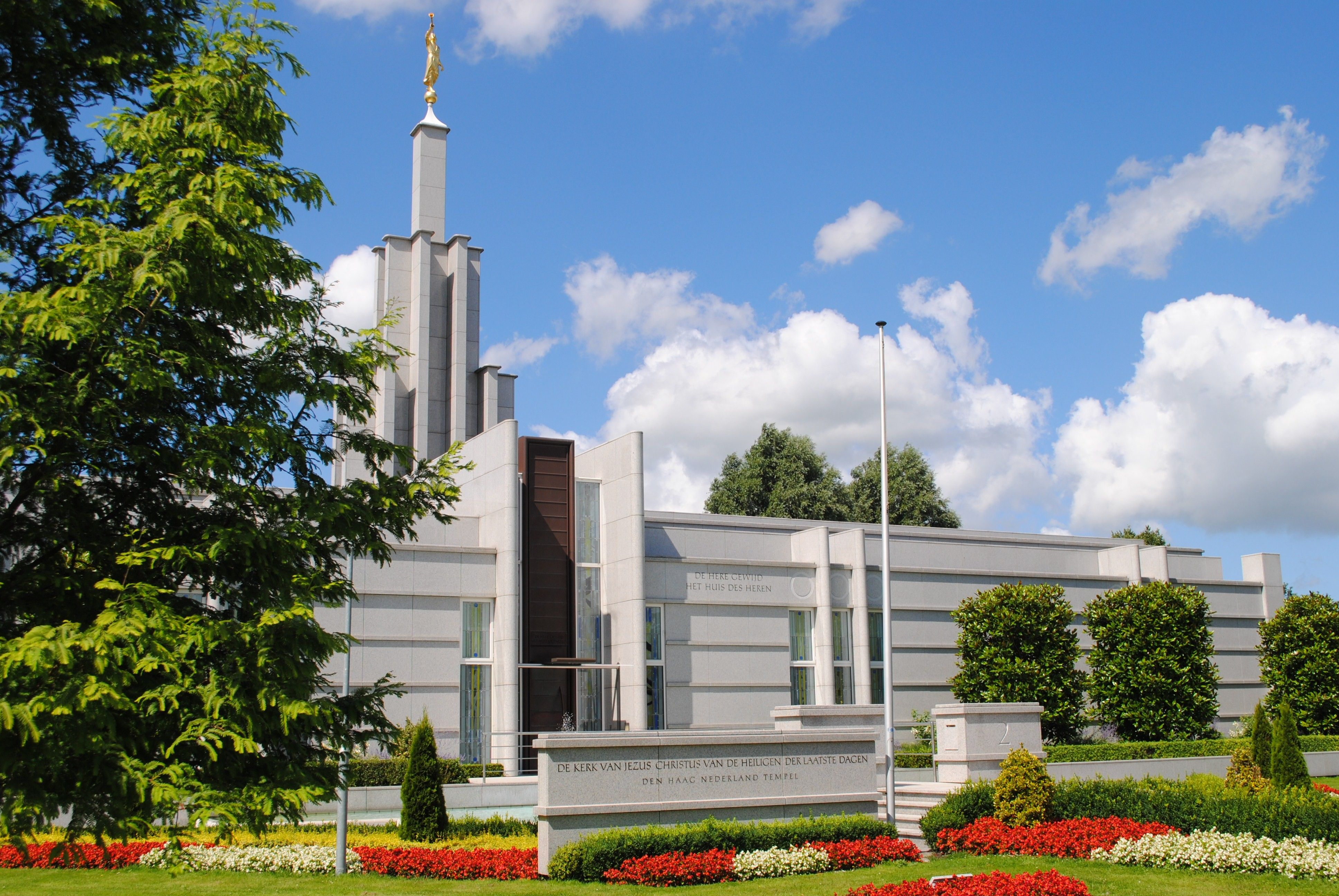 The Hague Netherlands Temple, with the name sign, scenery, and entrance.