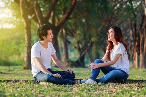 young man and young woman sitting and talking