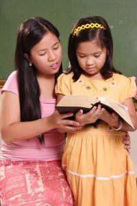 girls reading scriptures
