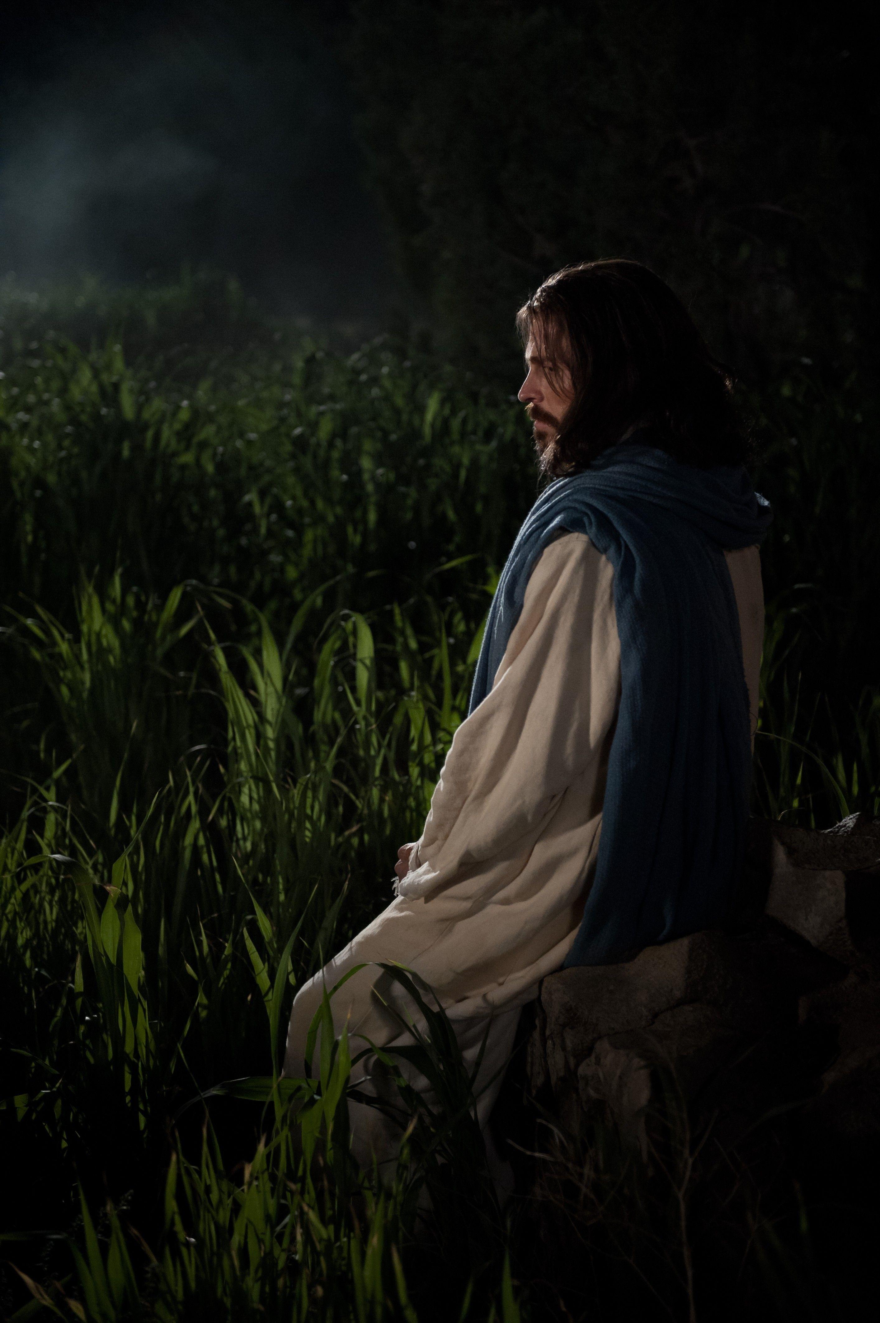Christ kneeling and praying in Gethsemane.