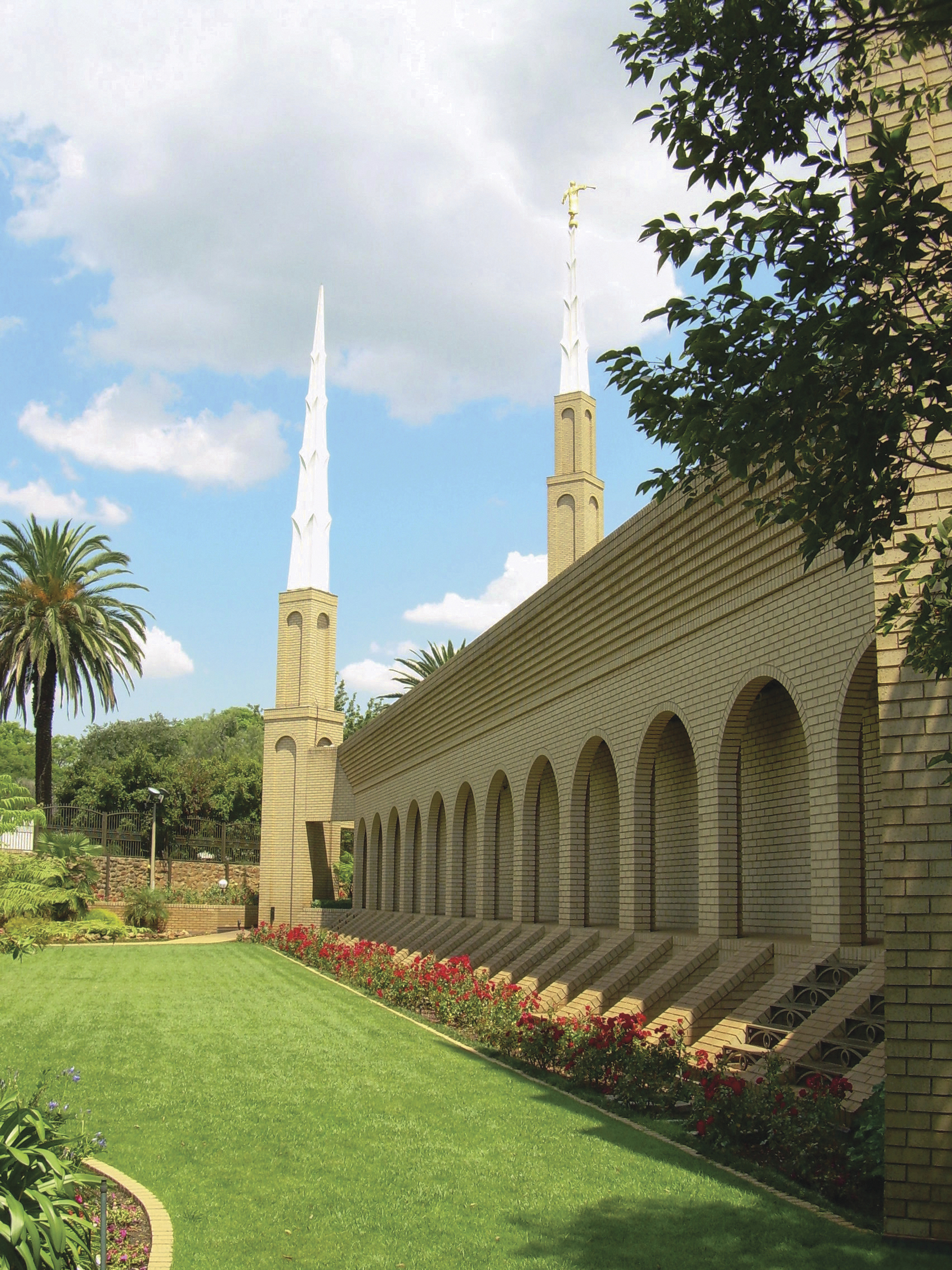 The Johannesburg South Africa Temple side view, including spires and scenery.
