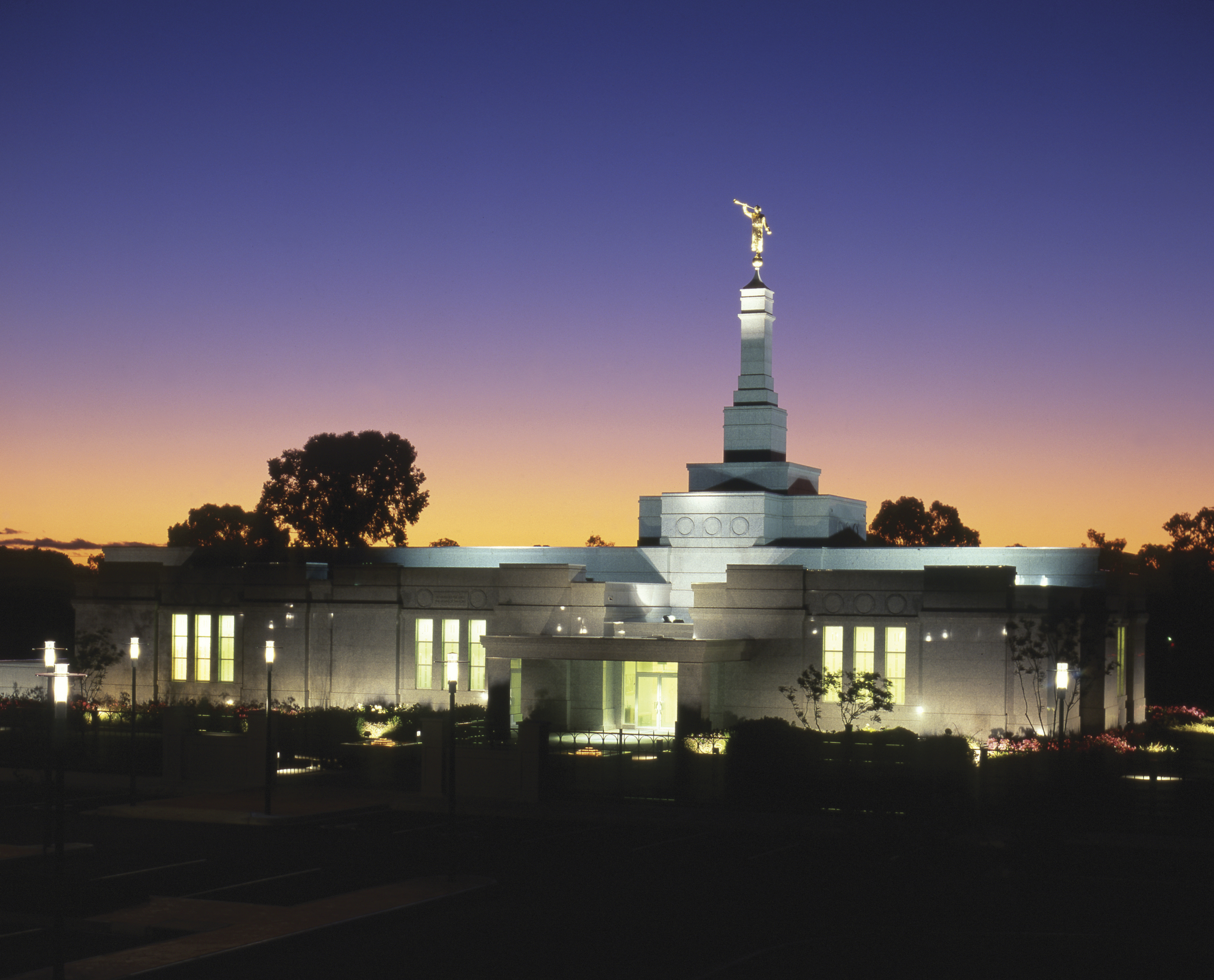 The exterior of the Adelaide Australia Temple is lit up at night.