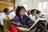 people singing hymns in sacrament meeting