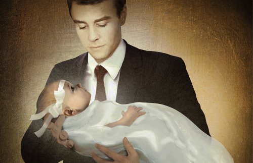 A father holding his infant daughter