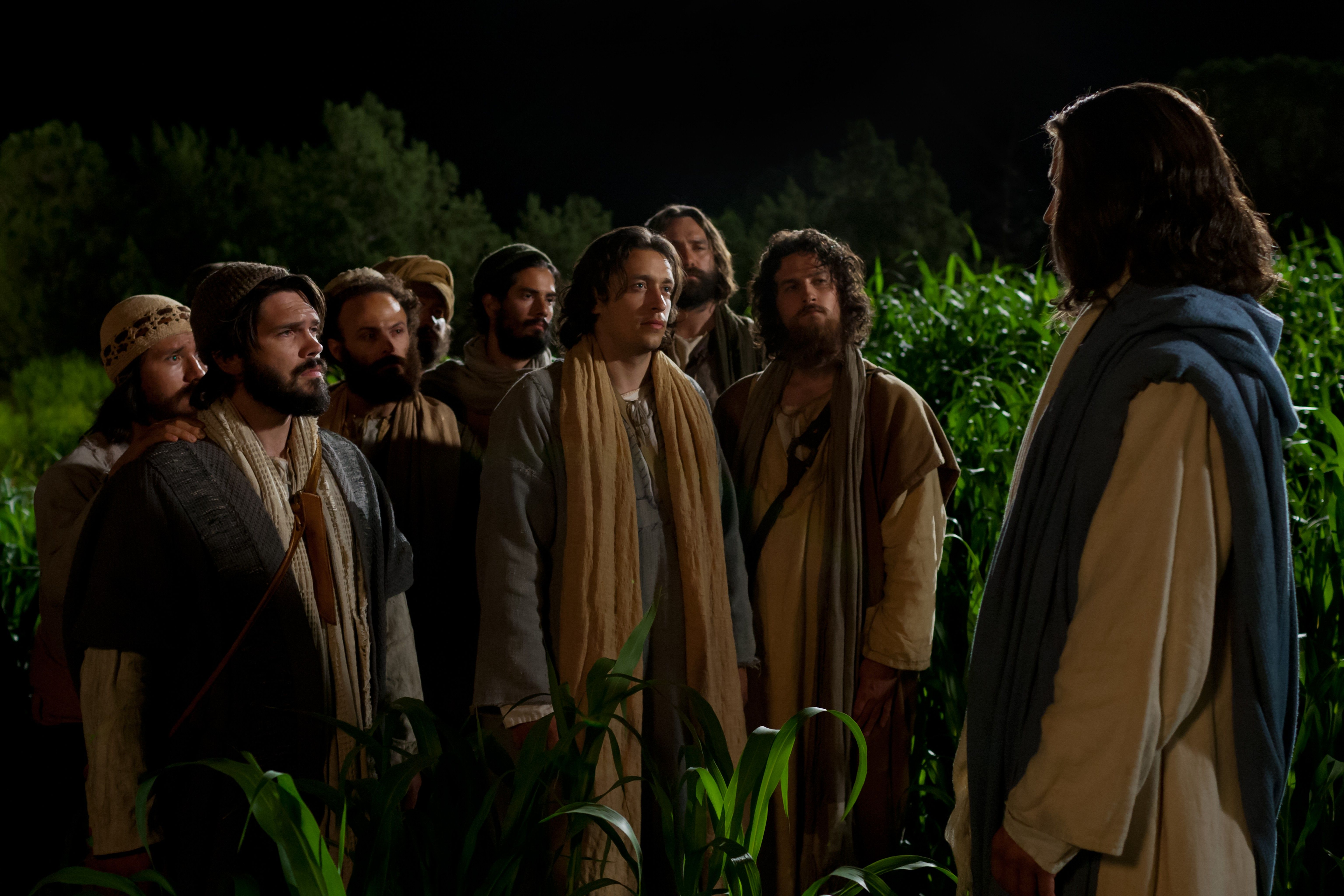 Jesus talking to the eleven disciples at night.