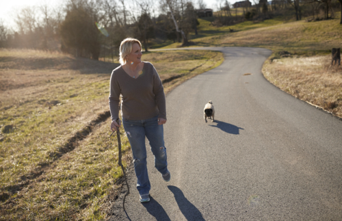 Shelly walking with her dog