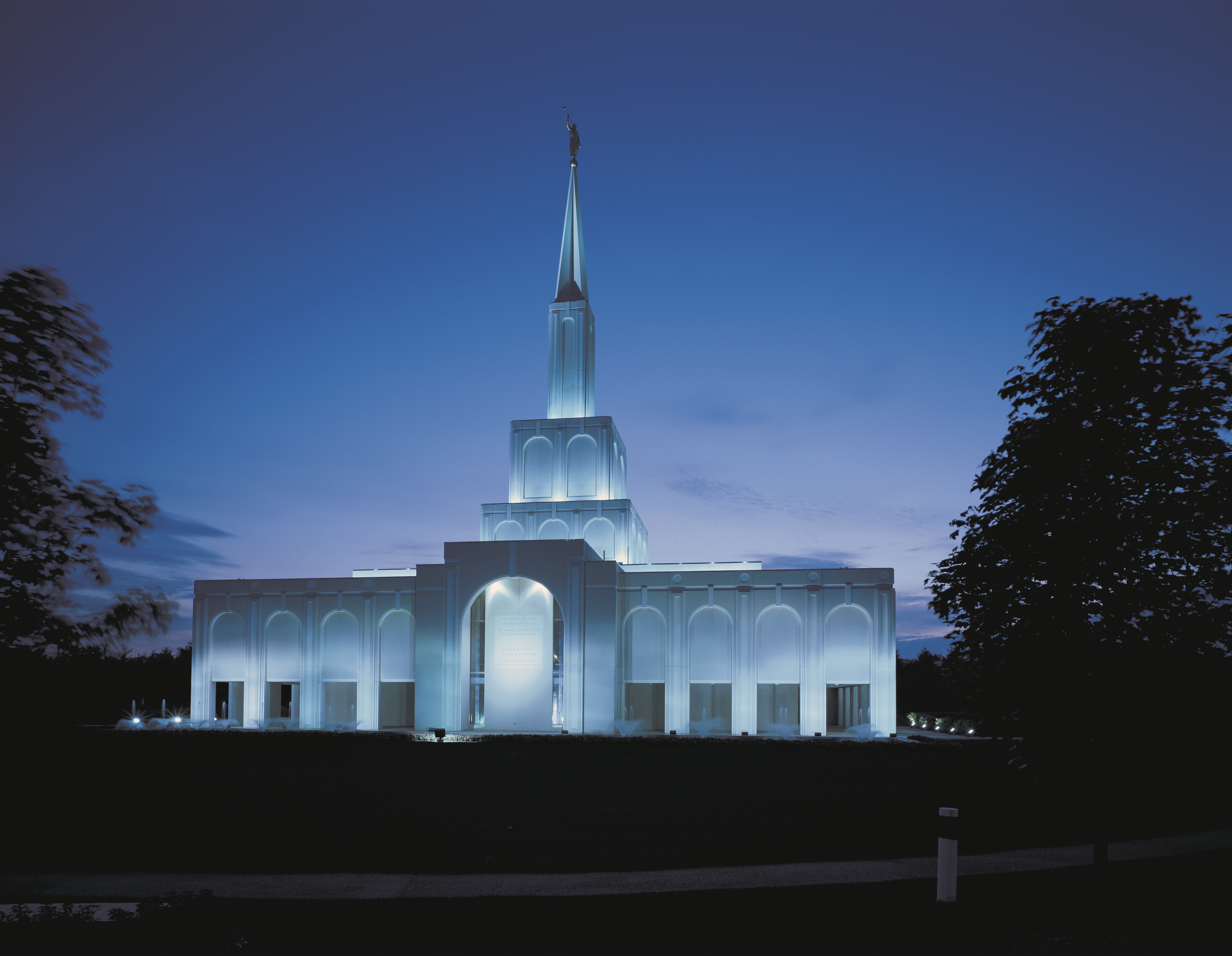 The Toronto Ontario Temple in the evening, including the entrance and scenery.