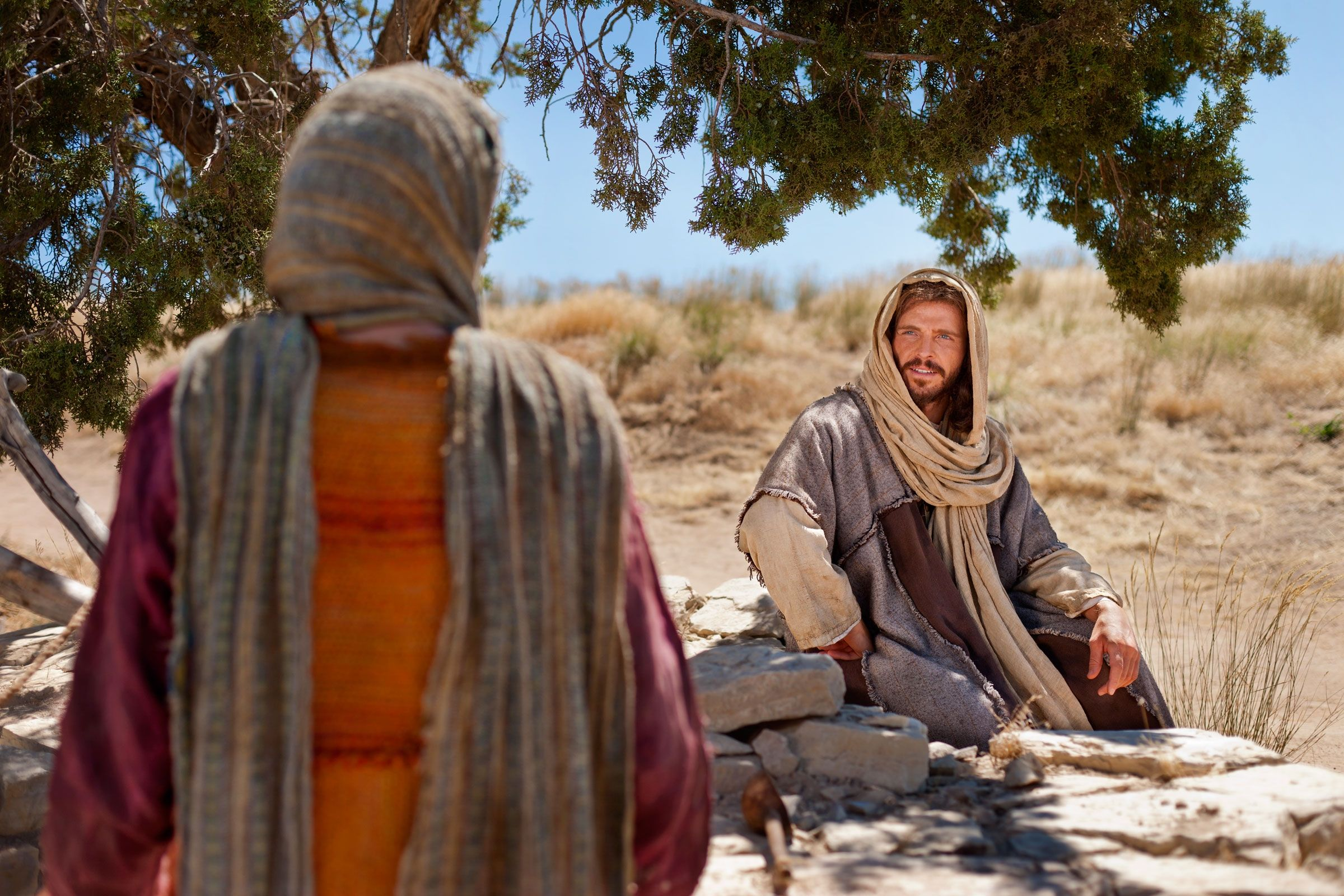 Jesus asks a Samaritan woman to give Him drink.