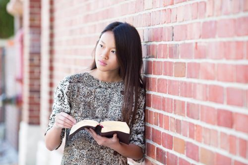 Young single adult reading her scriptures