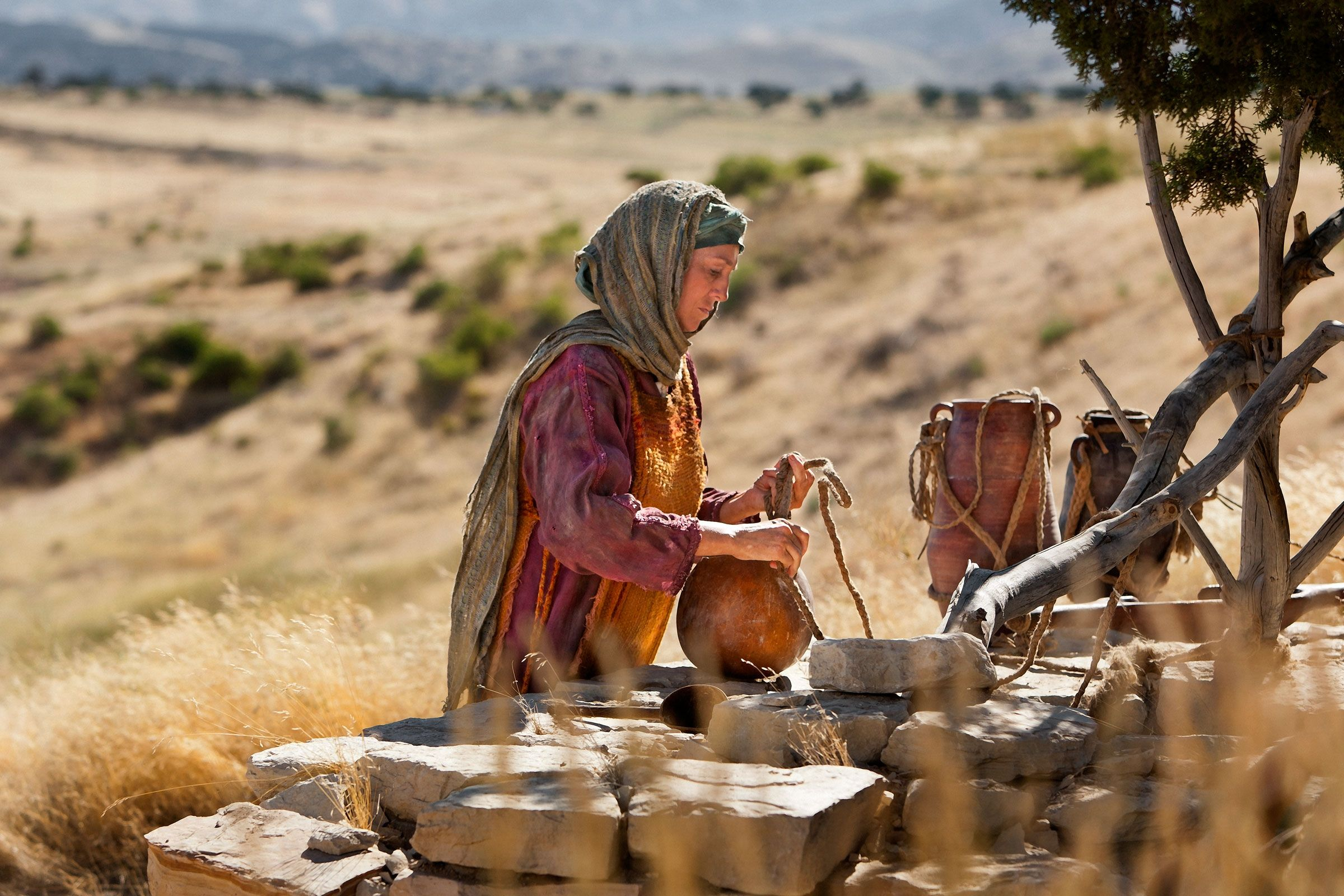 A woman of Samaria questions Jesus for speaking to her.