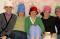 Ward Relief Society presidency wearing hats