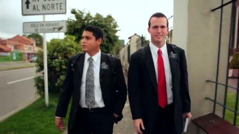 Two missionaries walking on the street