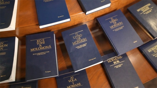 Many Books of Mormon in different languages displayed