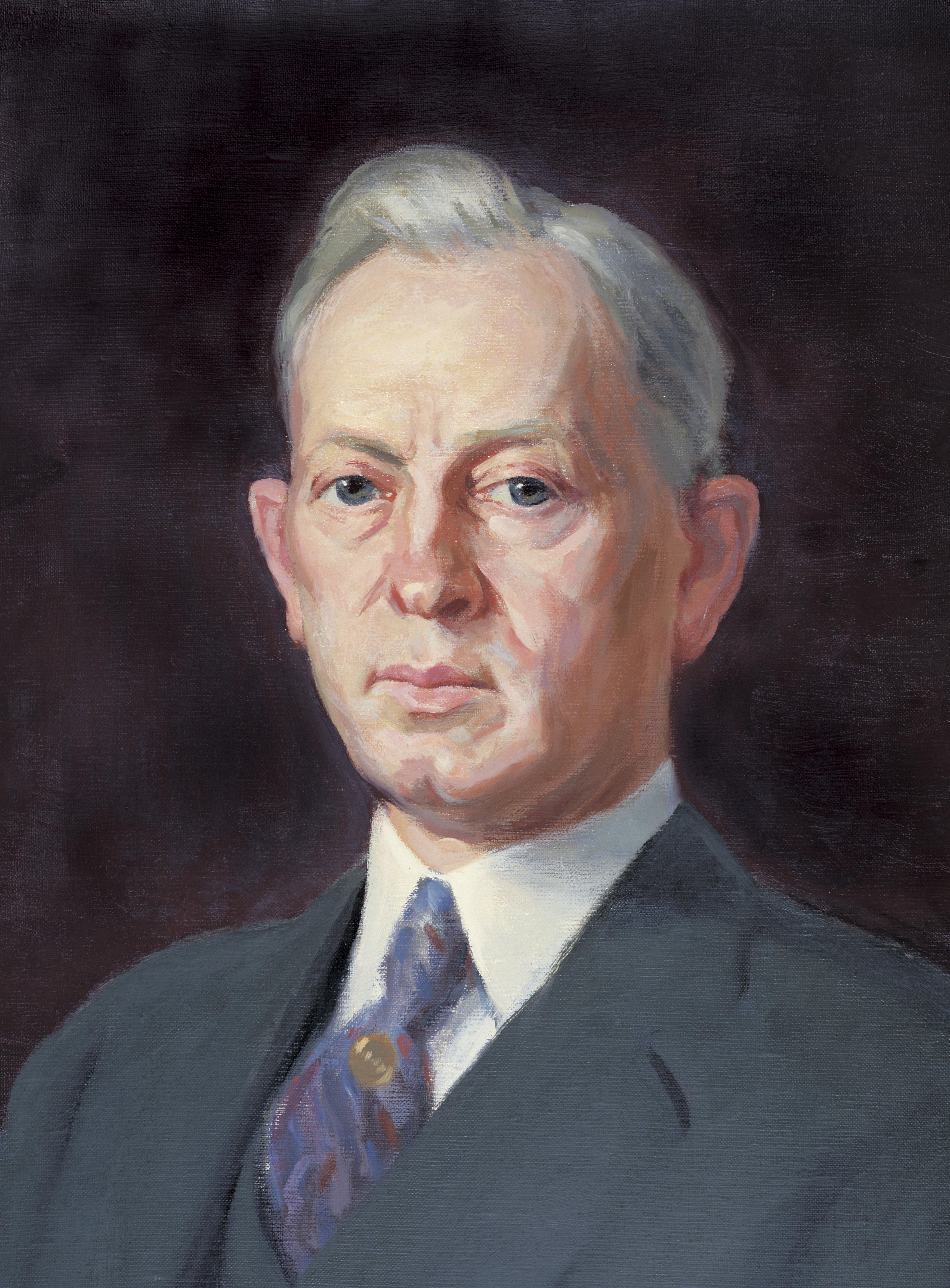 A portrait painting of the prophet Joseph Fielding Smith in a suit.