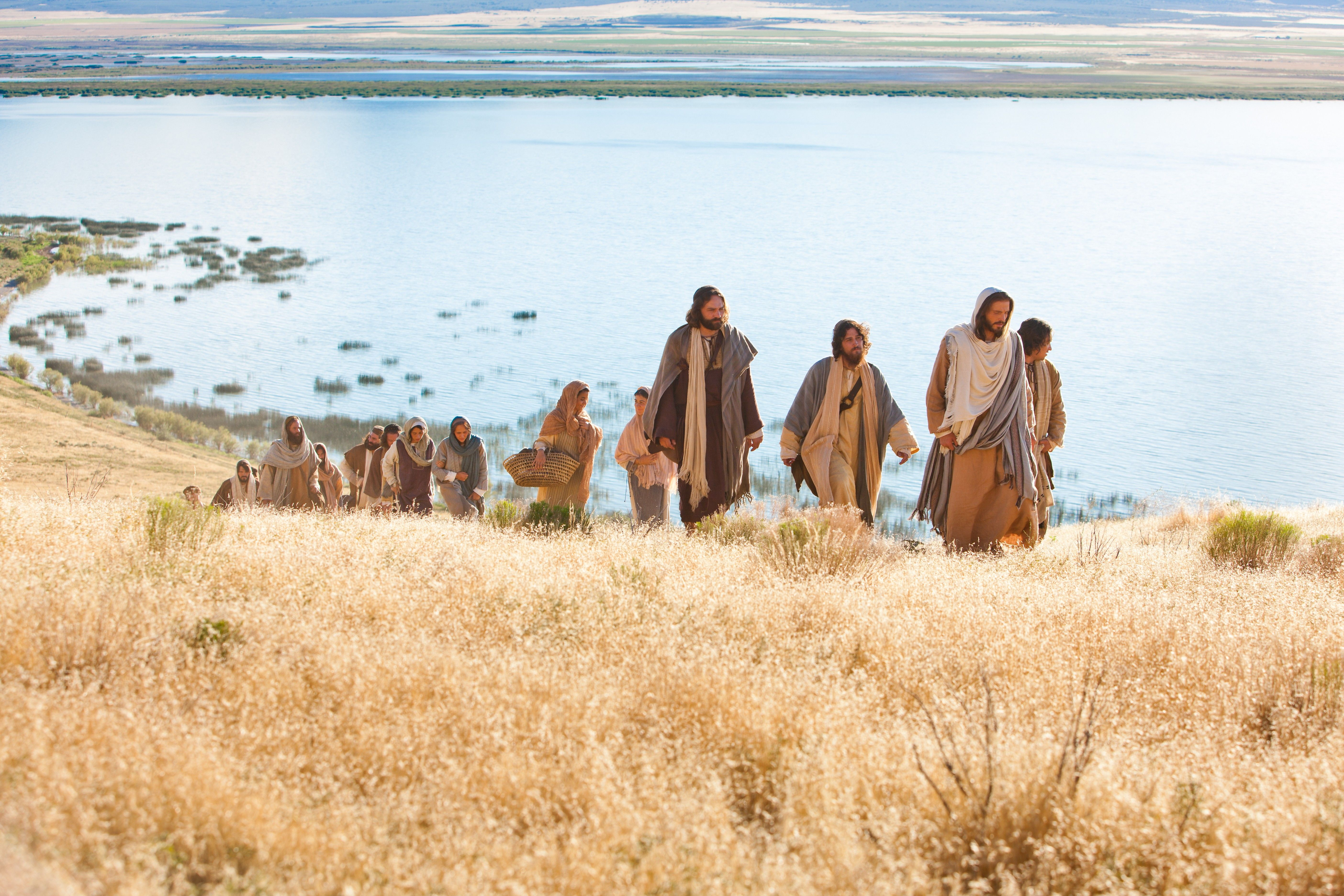 Men and women gather to come listen to Jesus as He gives His Sermon on the Mount.
