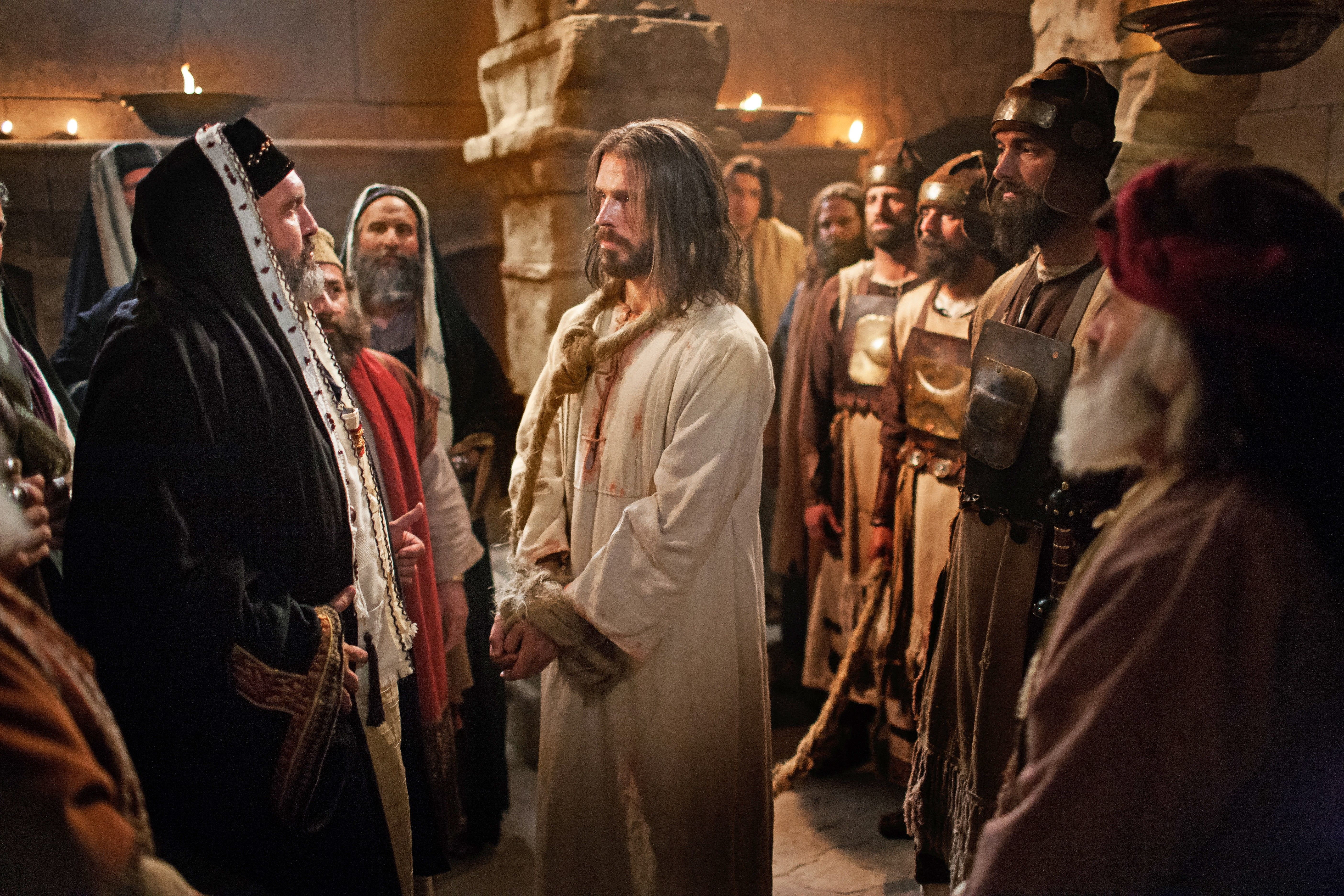 Jesus standing bound before Caiaphas and the Sanhedrin.