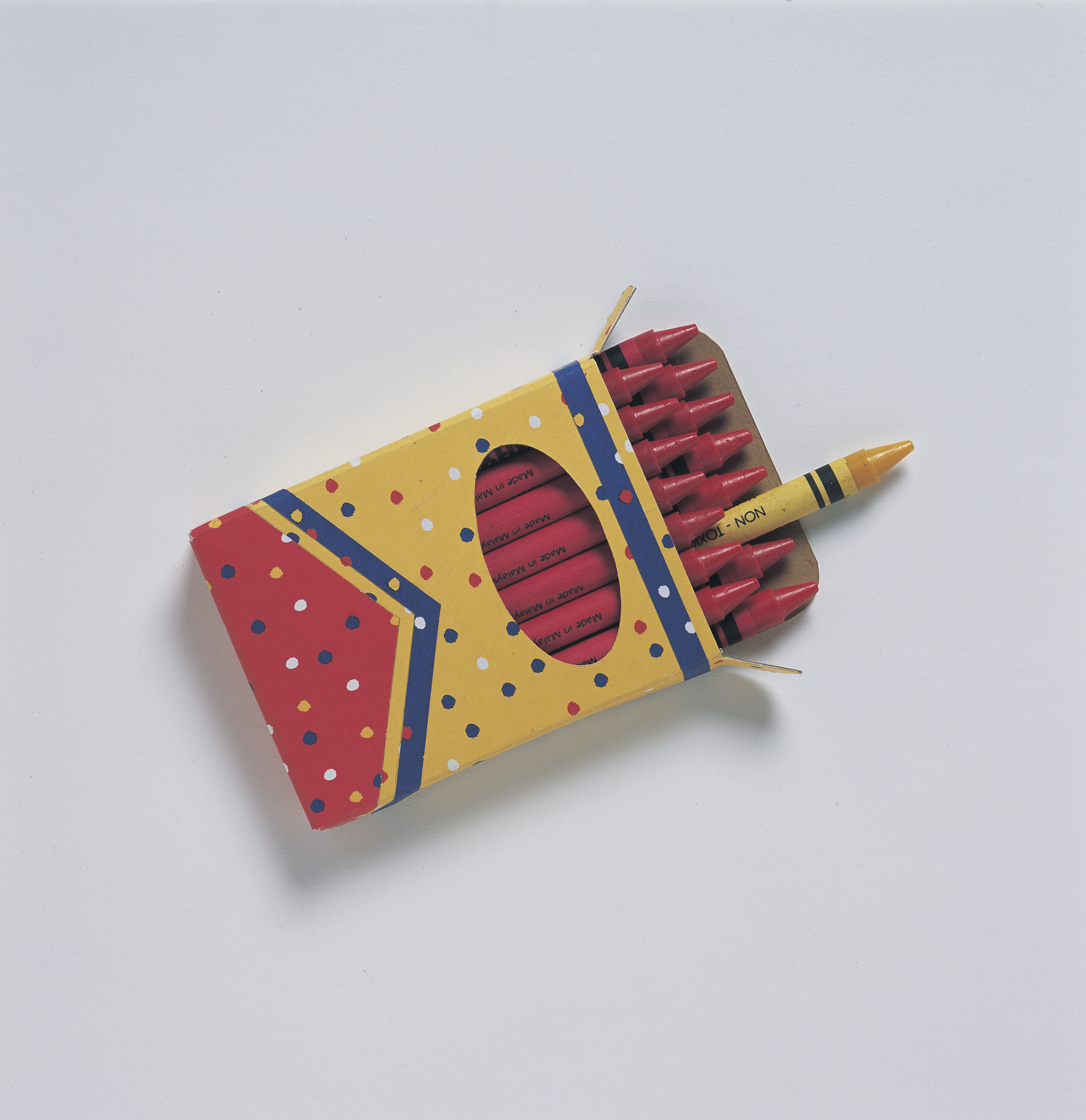 One yellow crayon in a box of red crayons.