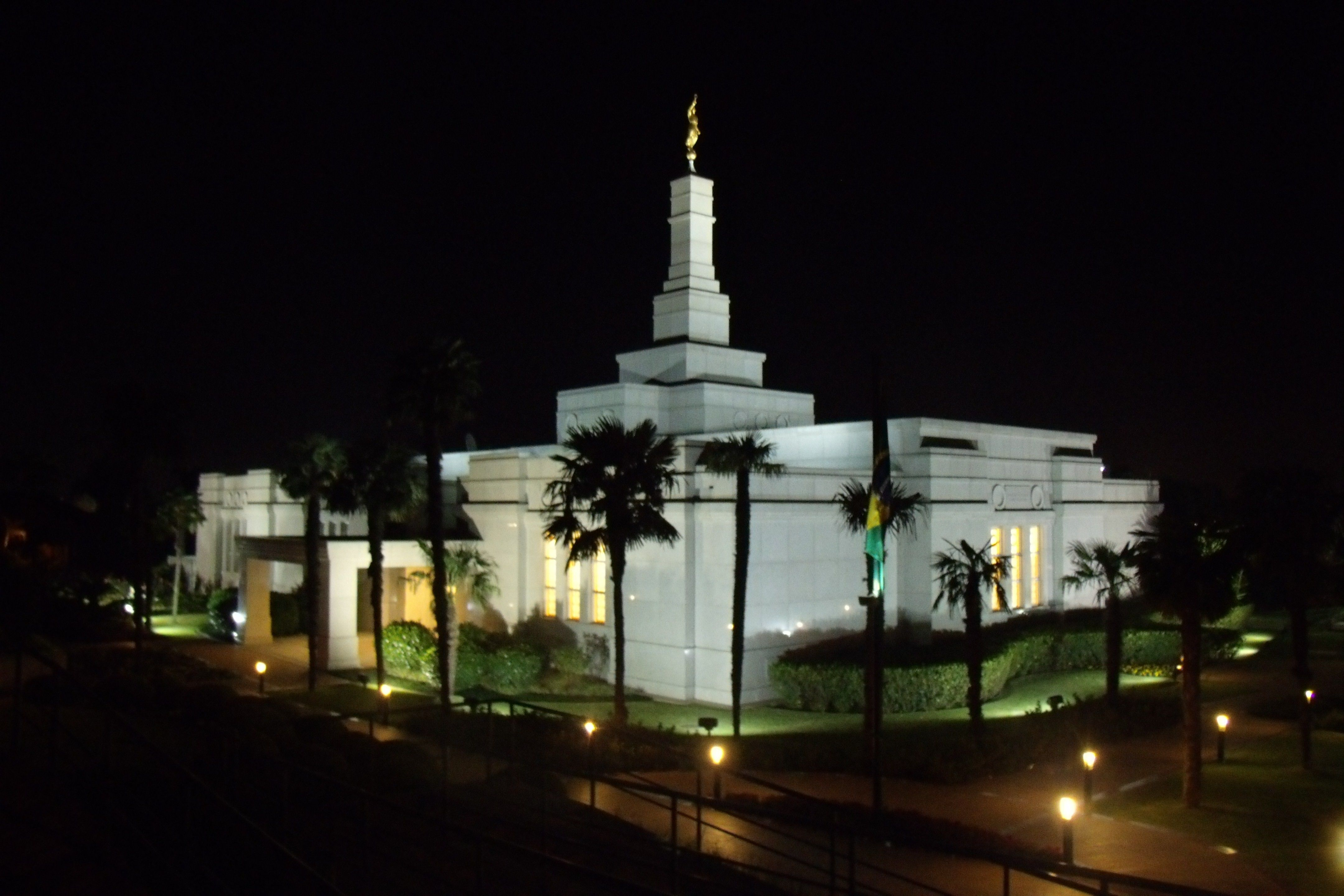 The Porto Alegre Brazil Temple in the evening, including the entrance and scenery.