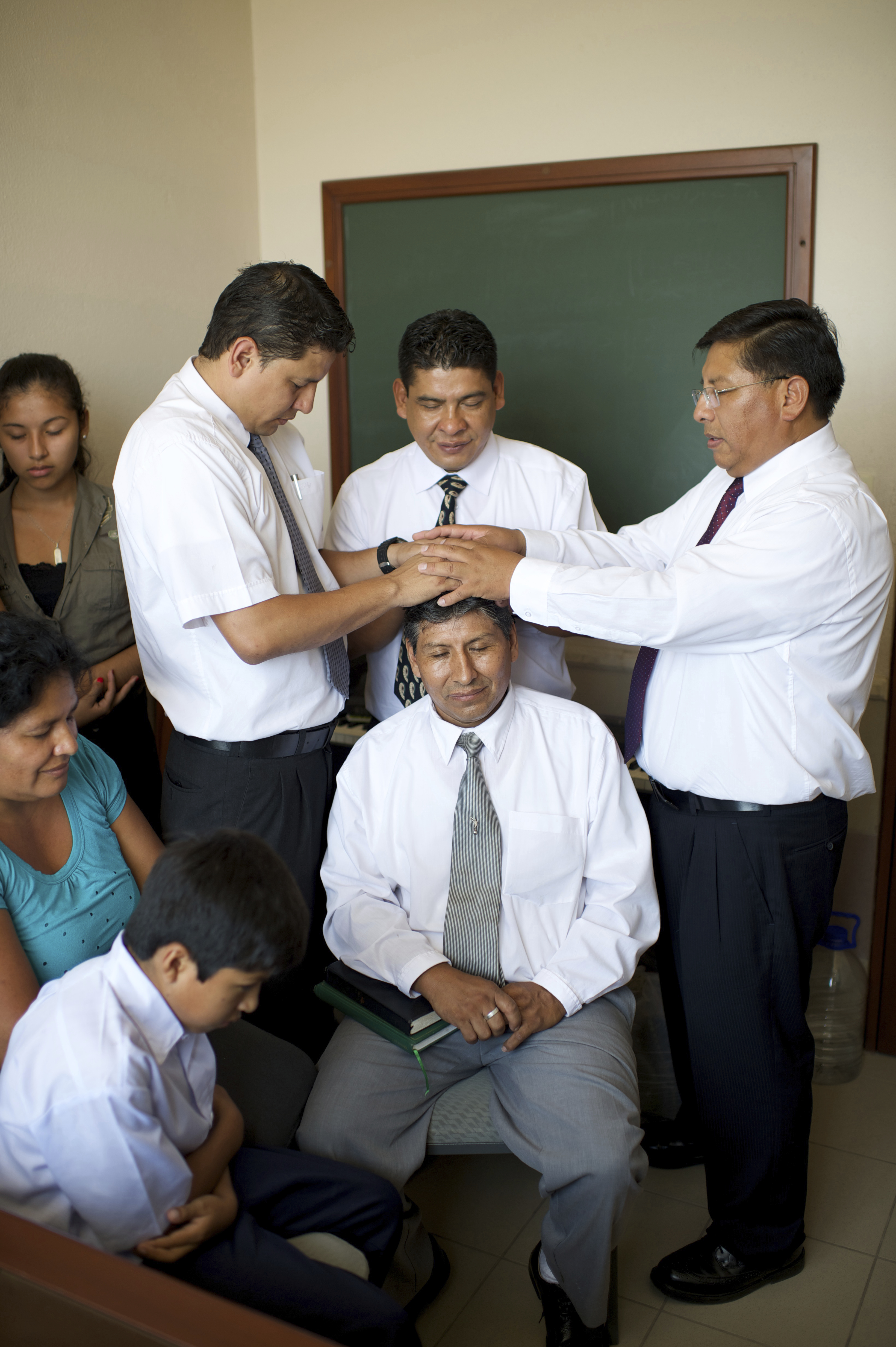 A man receiving a priesthood blessing in Bolivia.
