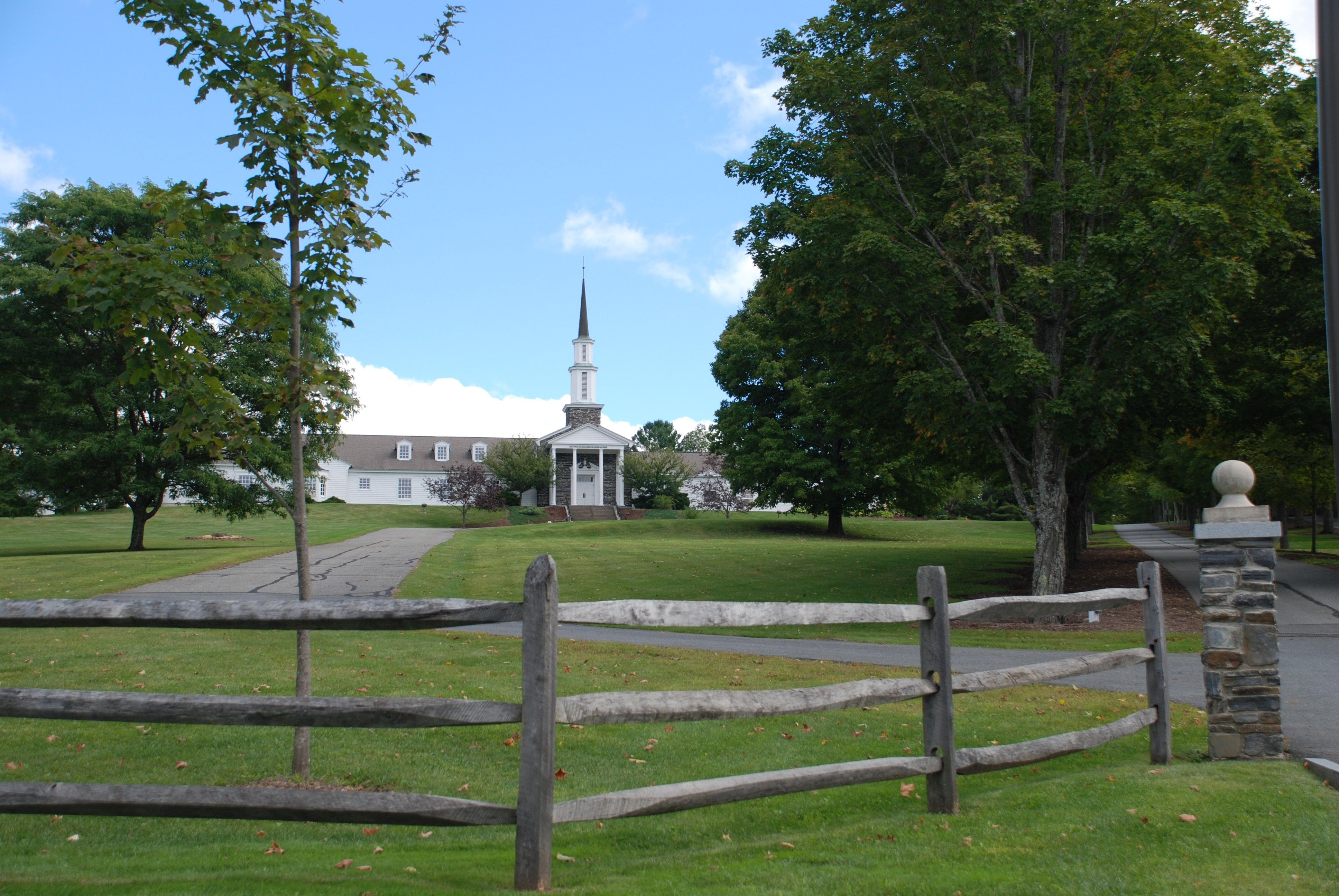 A historic meetinghouse in Sharon, Vermont, shown in the distance.