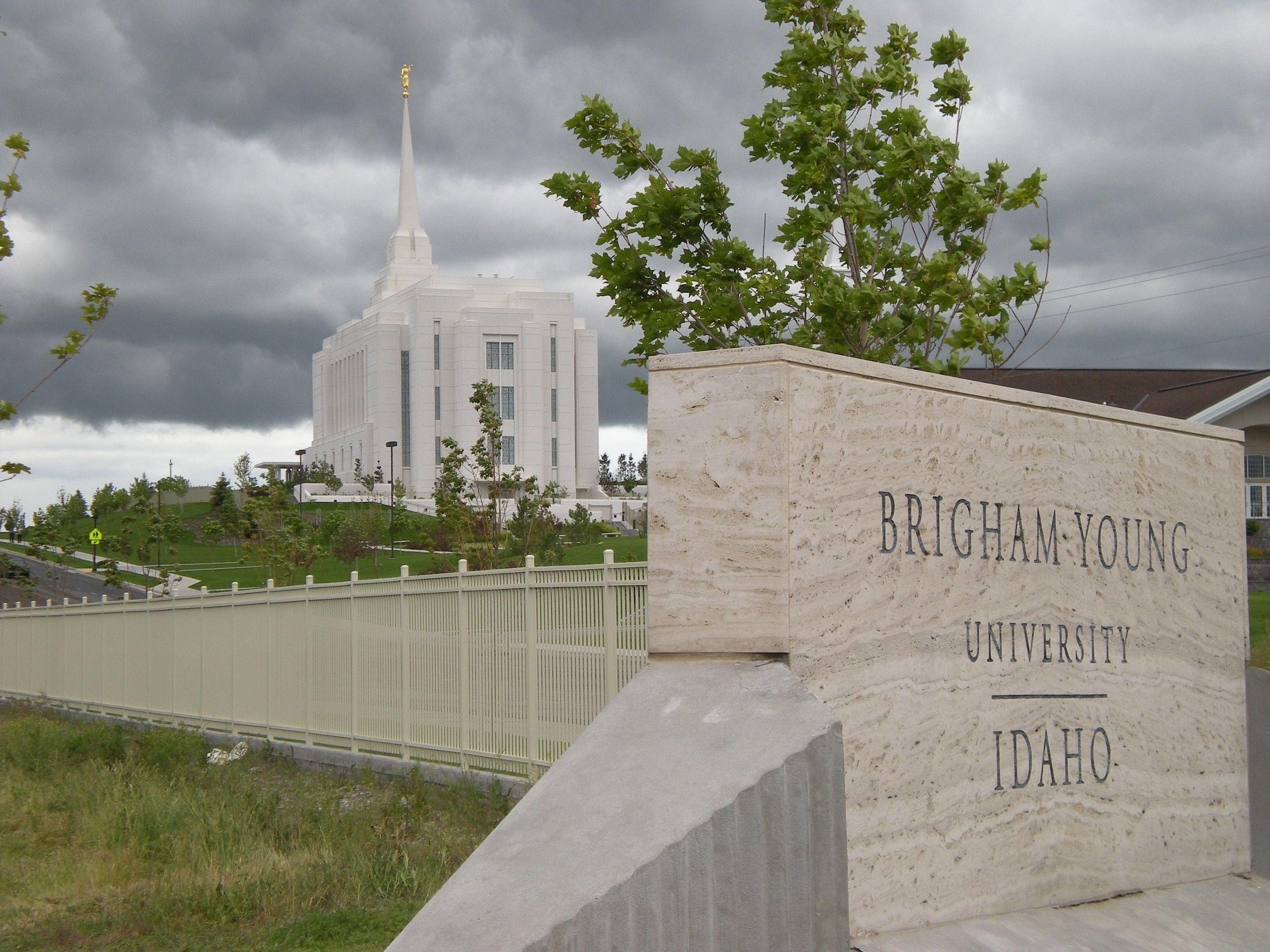 The entire Rexburg Idaho Temple, including the school, name sign, and scenery.