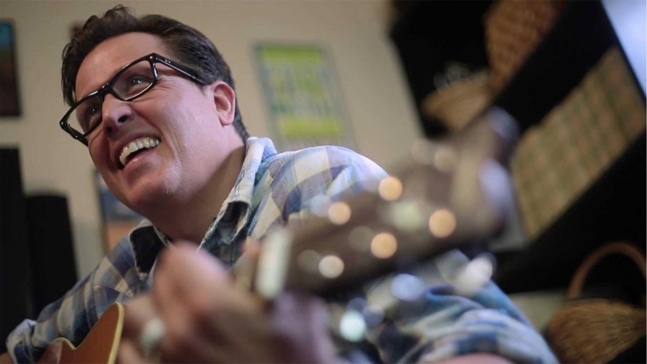 Tim Gates plays the guitar
