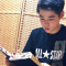 Young Man from Japan Reading Scriptures