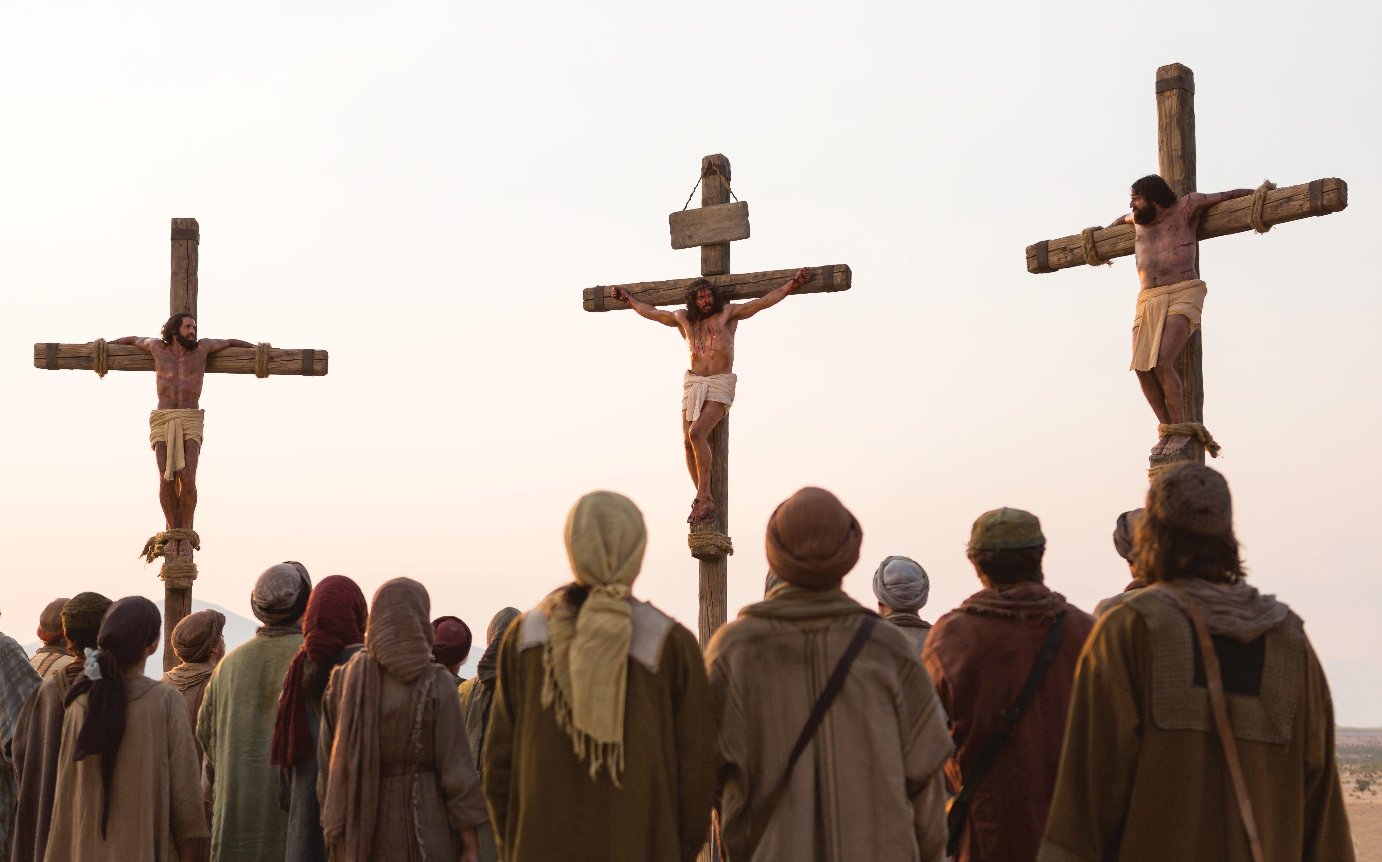 Jesus on the cross between two criminals.