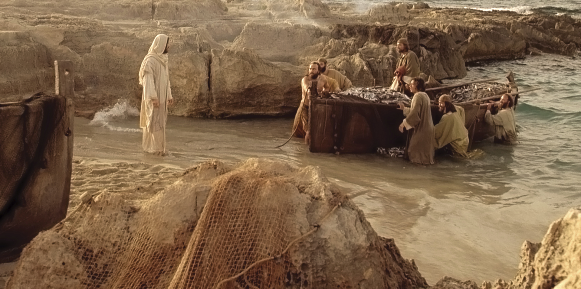 The disciples greet Christ on the shore.