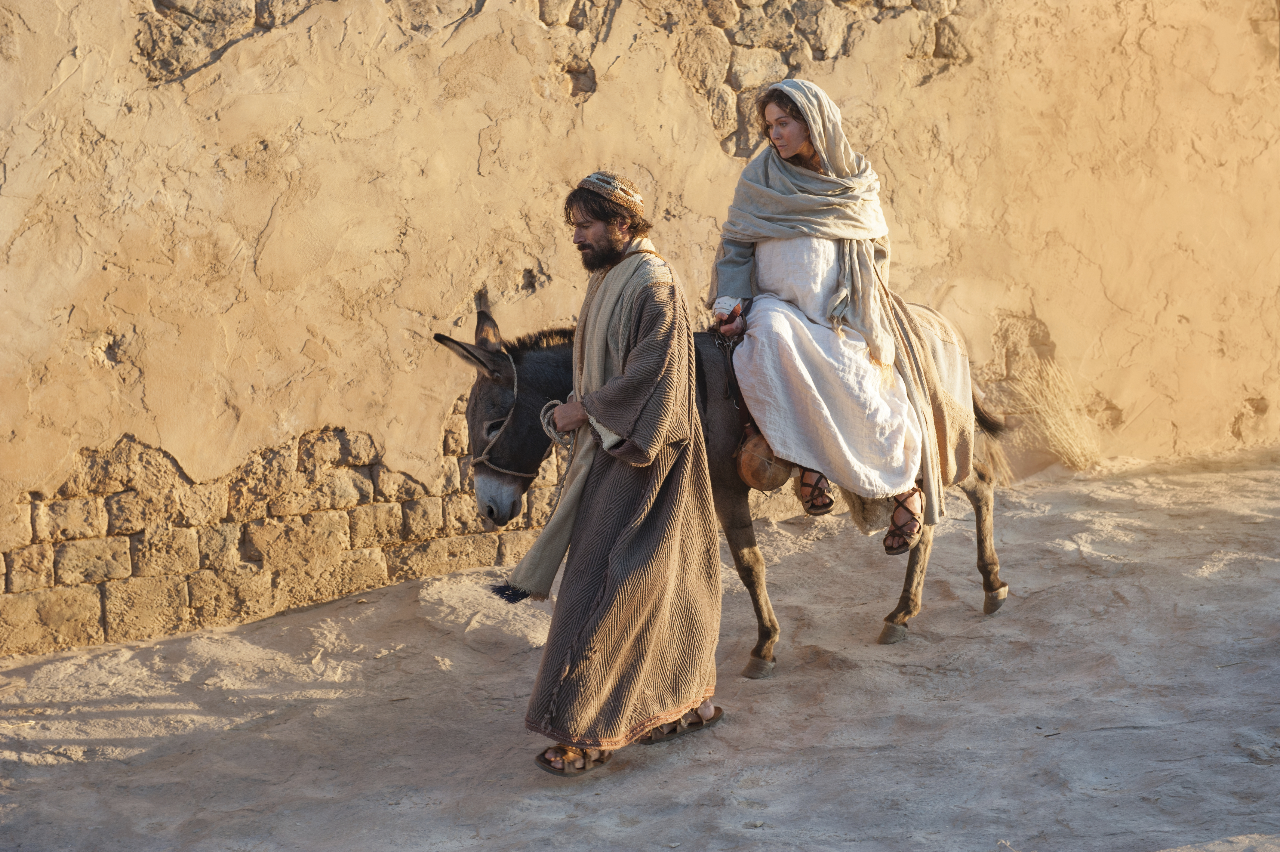 Mary and Joseph ride into Bethlehem at the end of their journey.