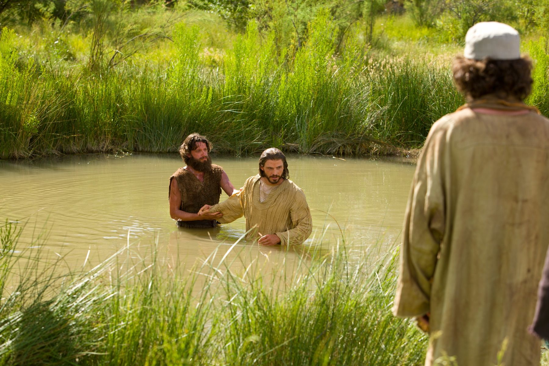 After being baptized, Jesus leaves the waters of Jordan.