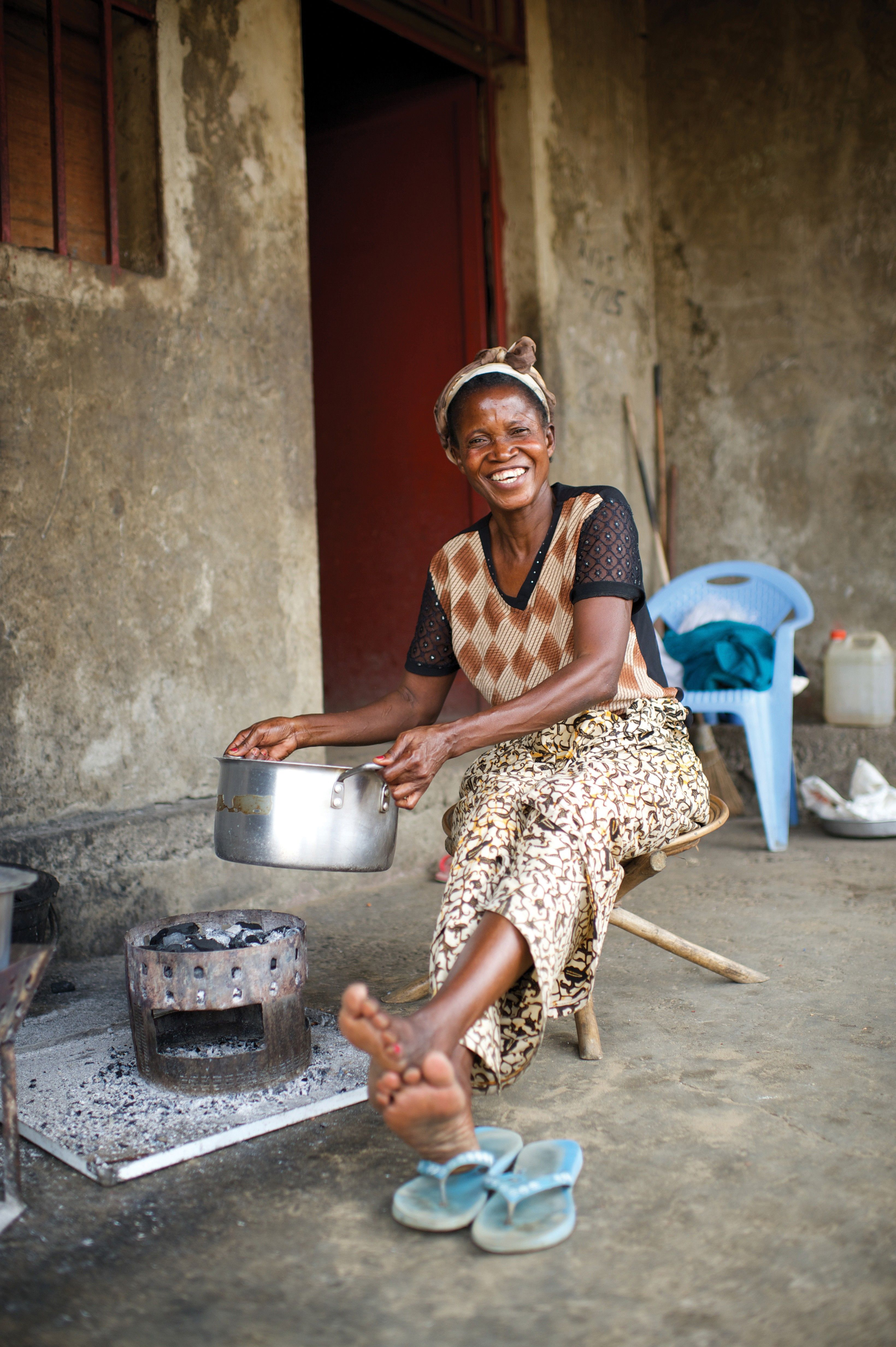 A woman in the Congo cooking outside.