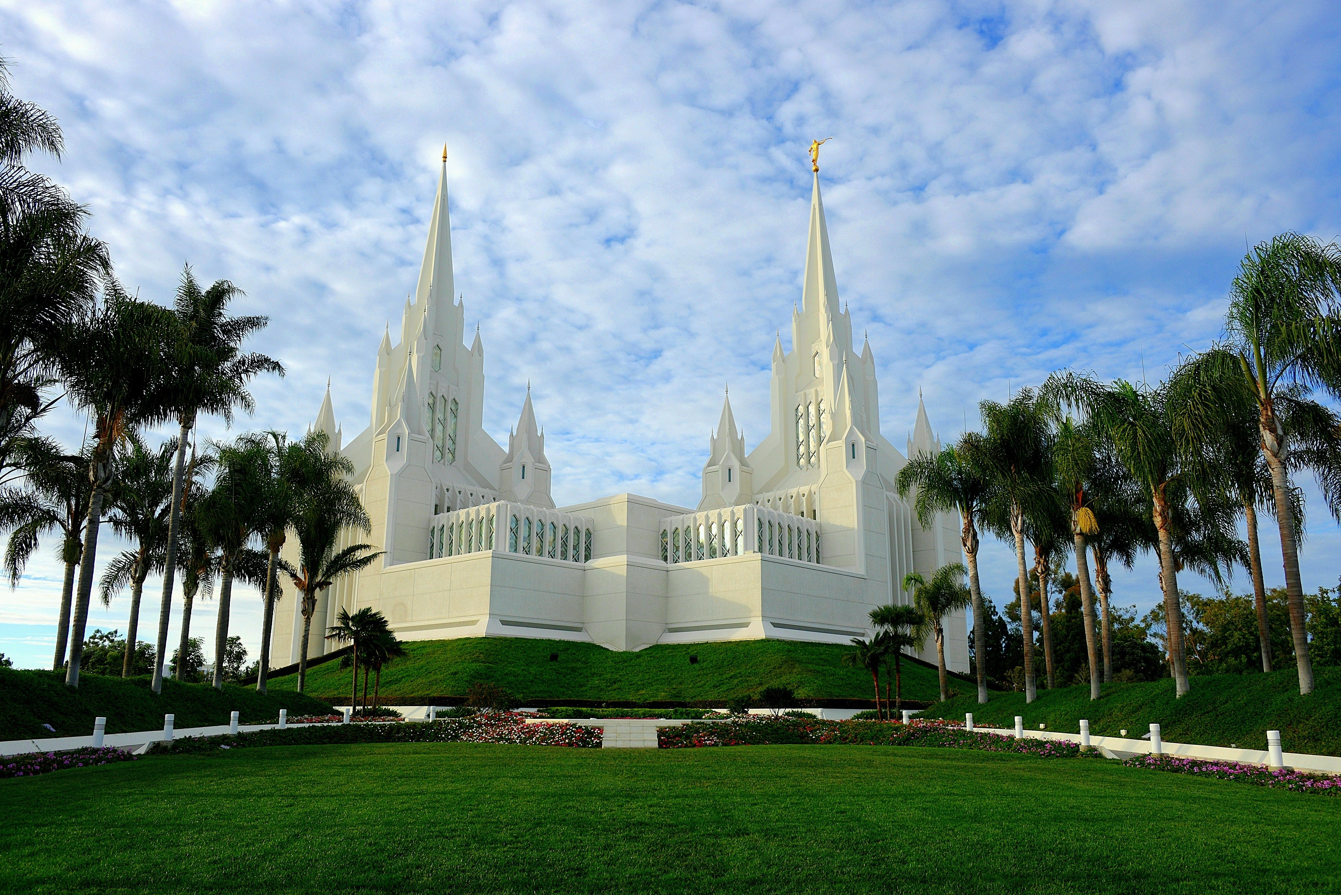 The San Diego California Temple and its lawns on a partly cloudy day.