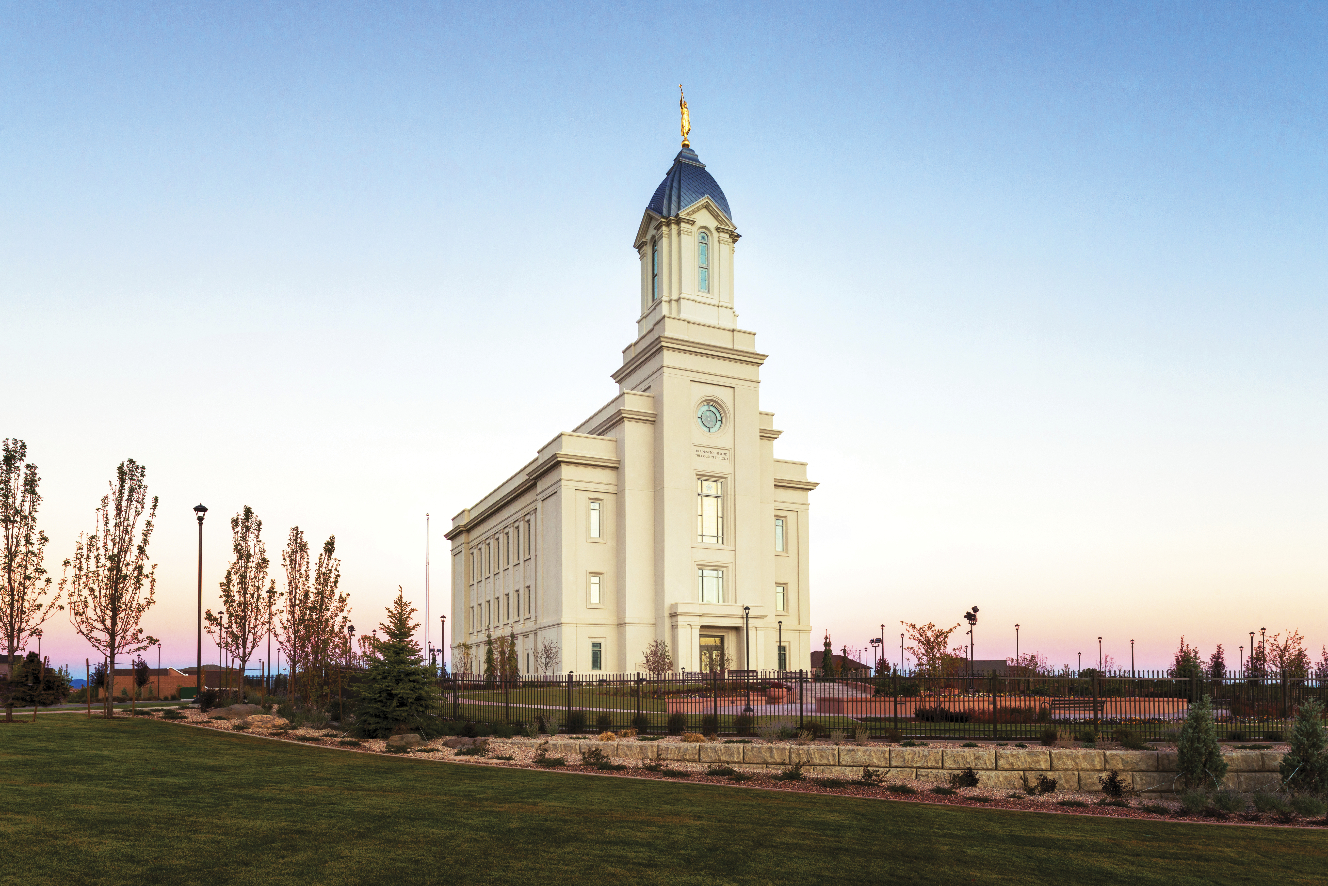 The exterior of the Cedar City Utah Temple at sunset.