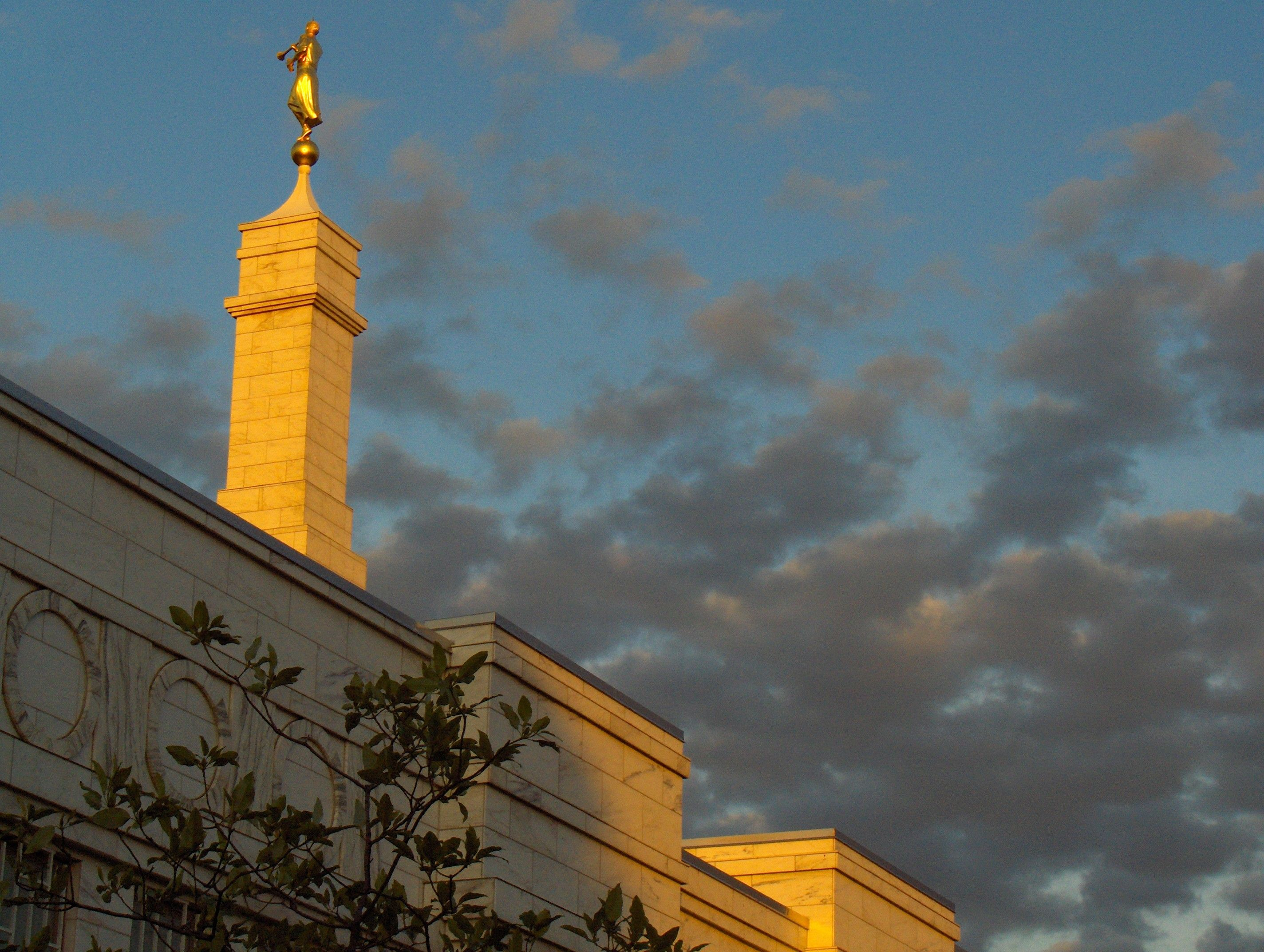 The angel Moroni on the Columbus Ohio Temple spire in the evening.