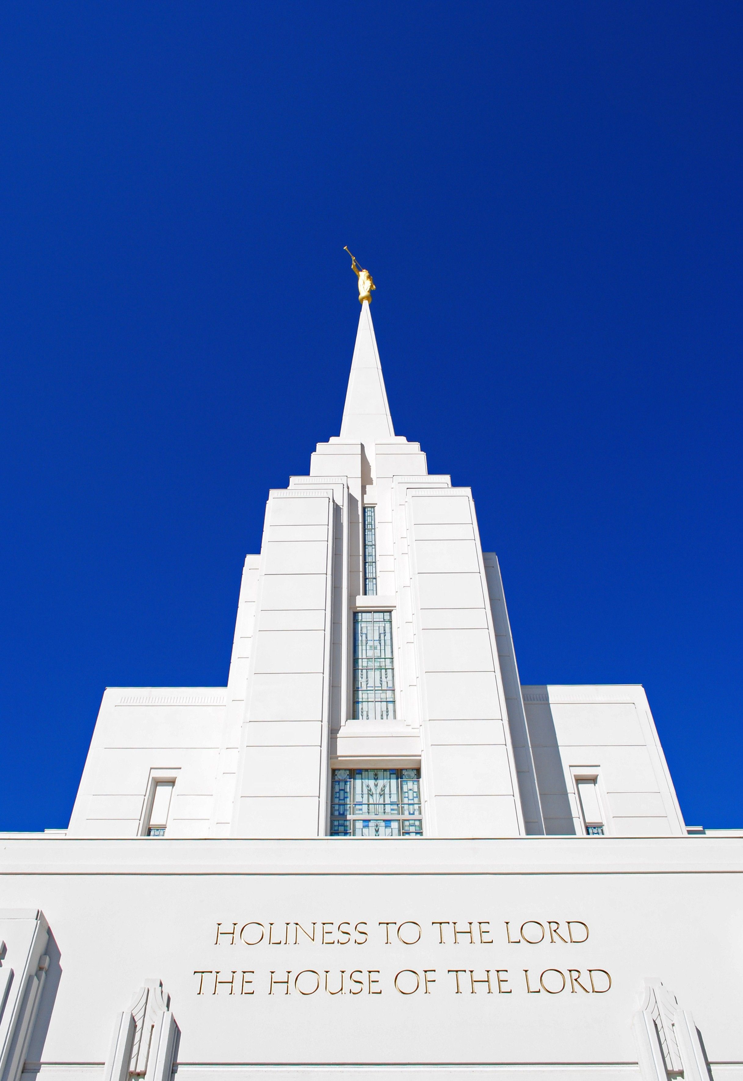 """The Rexburg Idaho Temple inscription, """"Holiness to the Lord: The House of the Lord,"""" including the spire."""