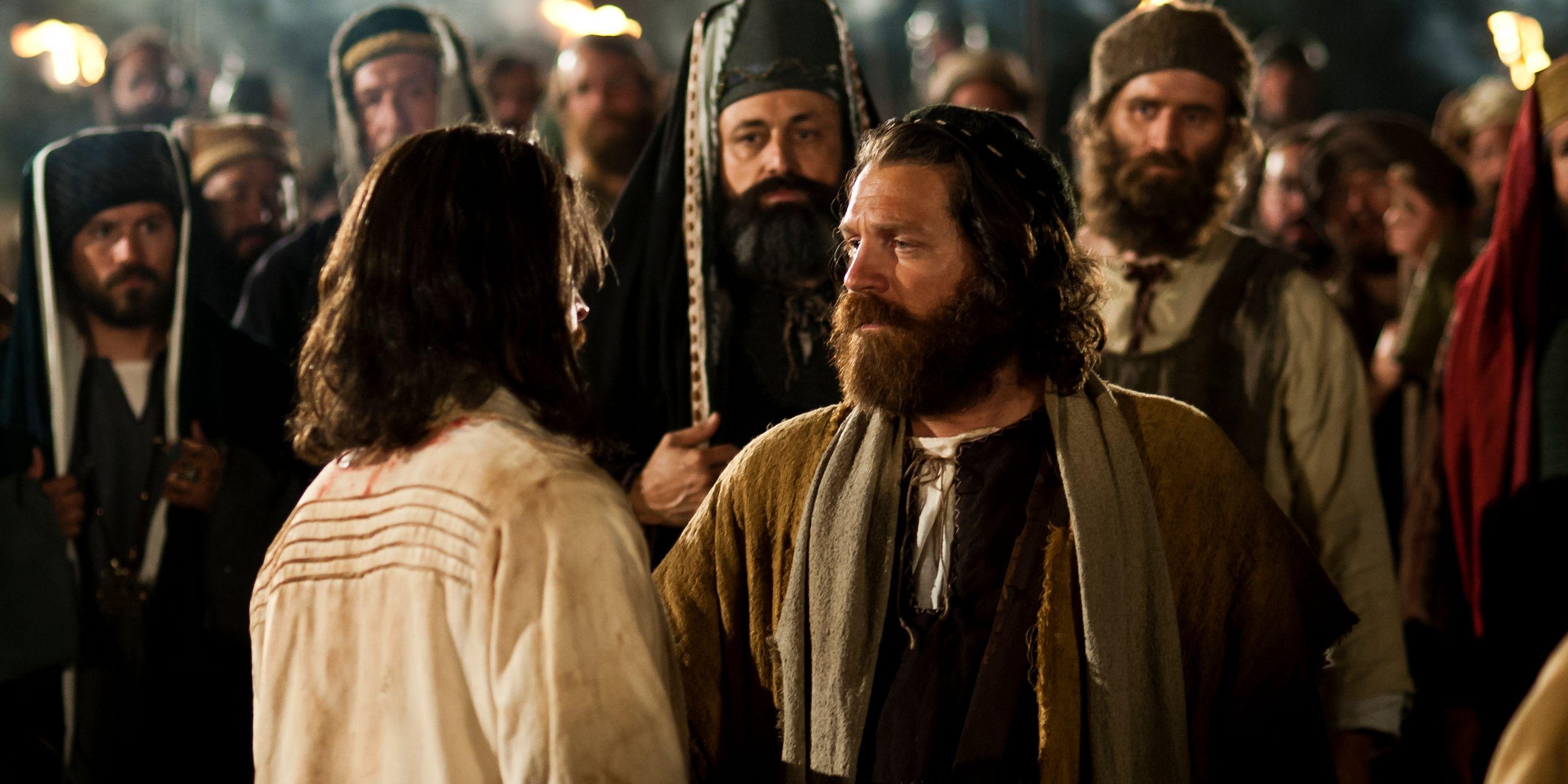 Judas kisses Christ's cheek in an act of betrayal.