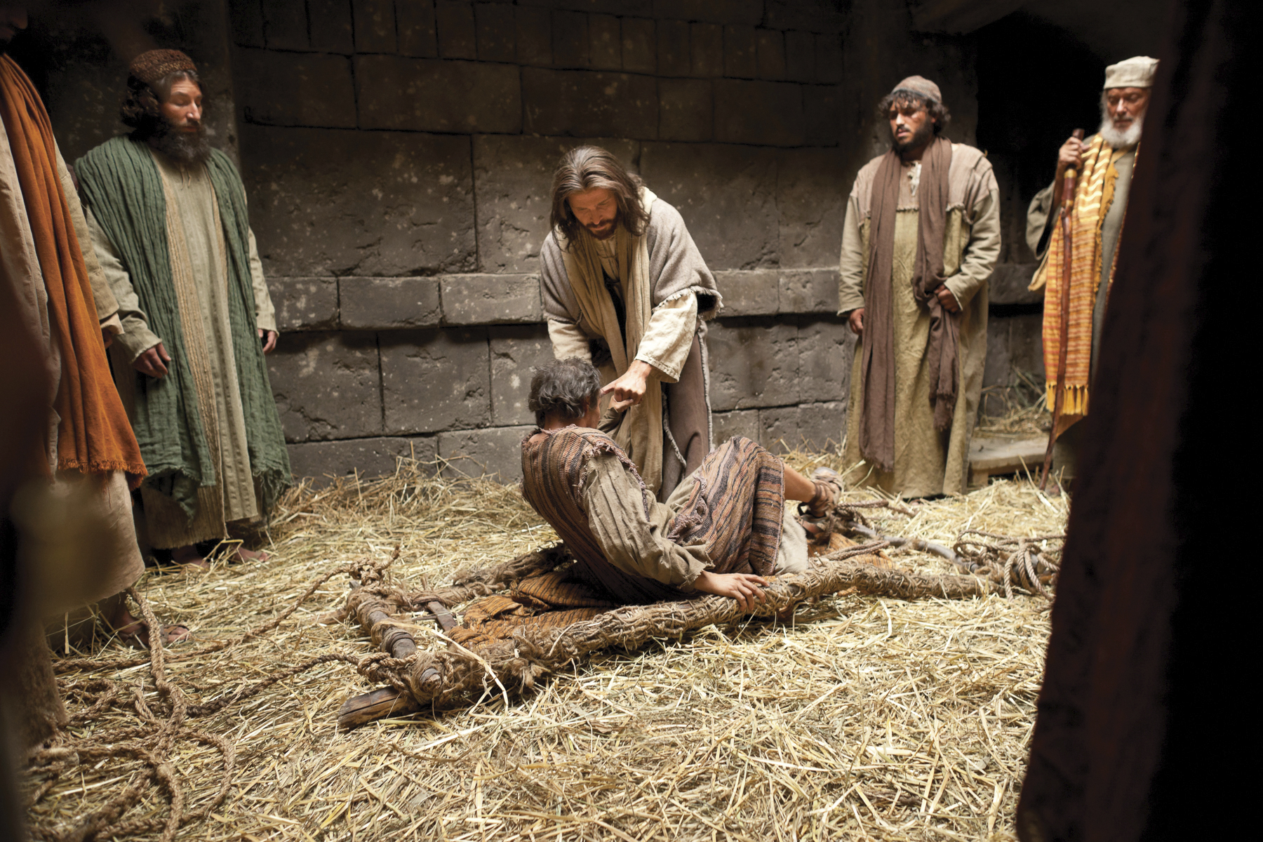 Jesus forgives the sins of the man stricken with palsy and heals him.
