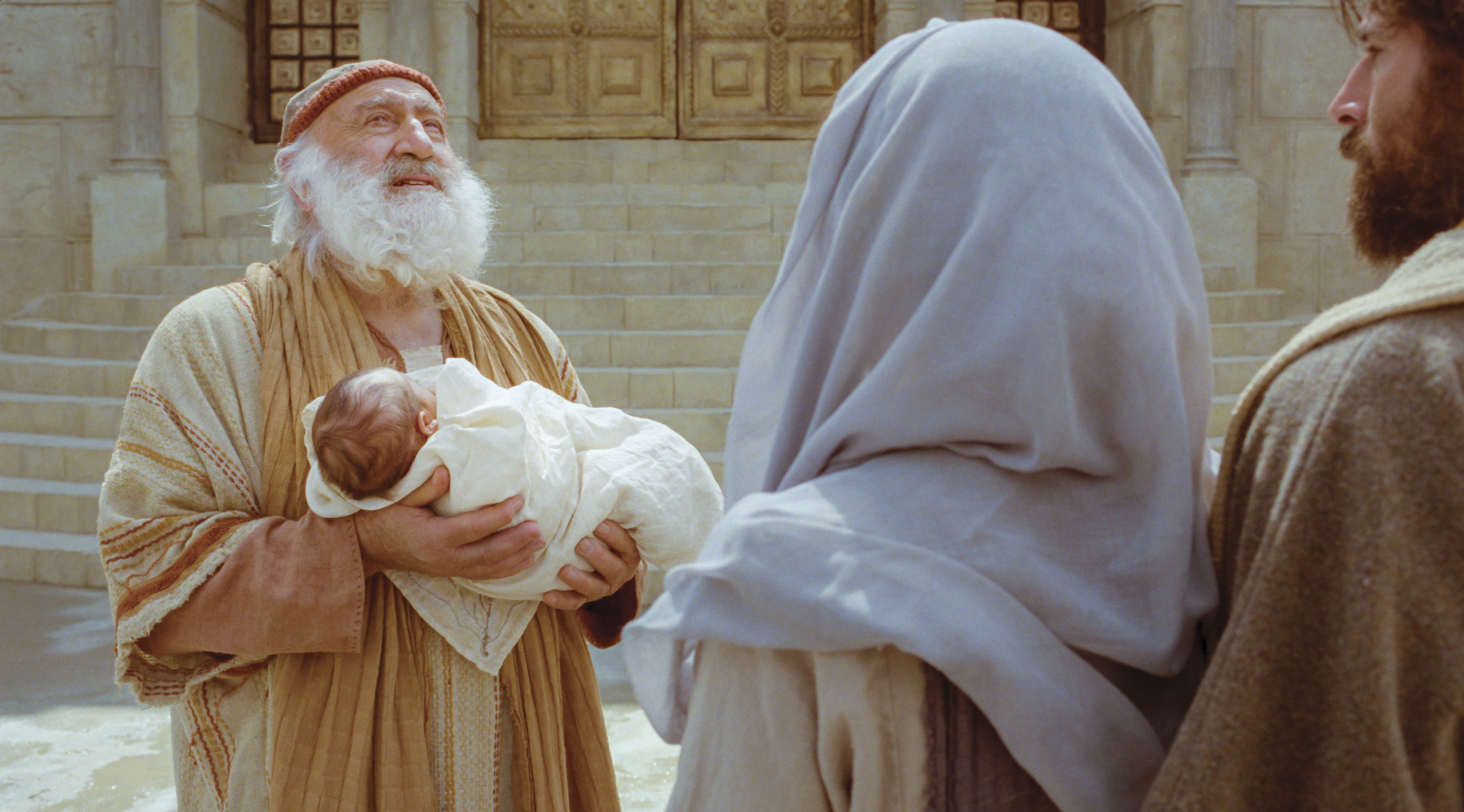 A priest holds Christ as a baby.