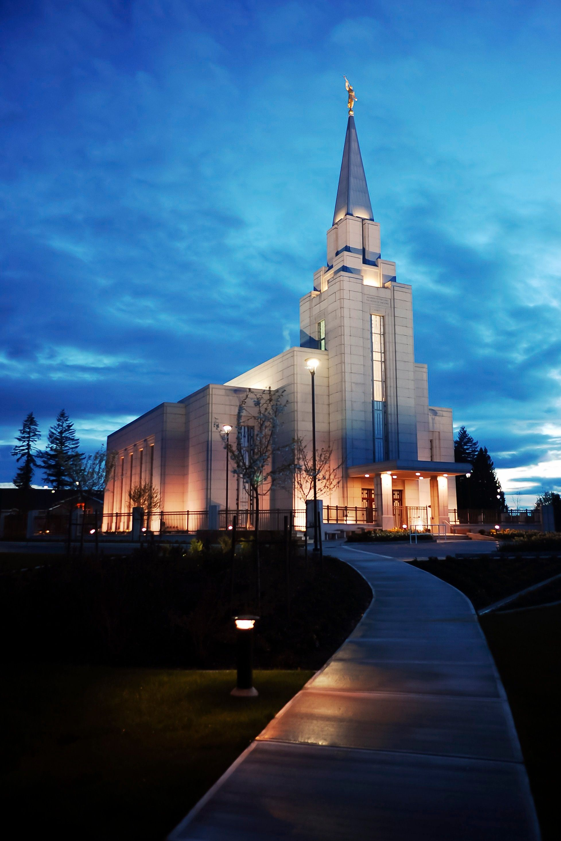 The Vancouver British Columbia Temple in the evening, with the entrance and grounds.