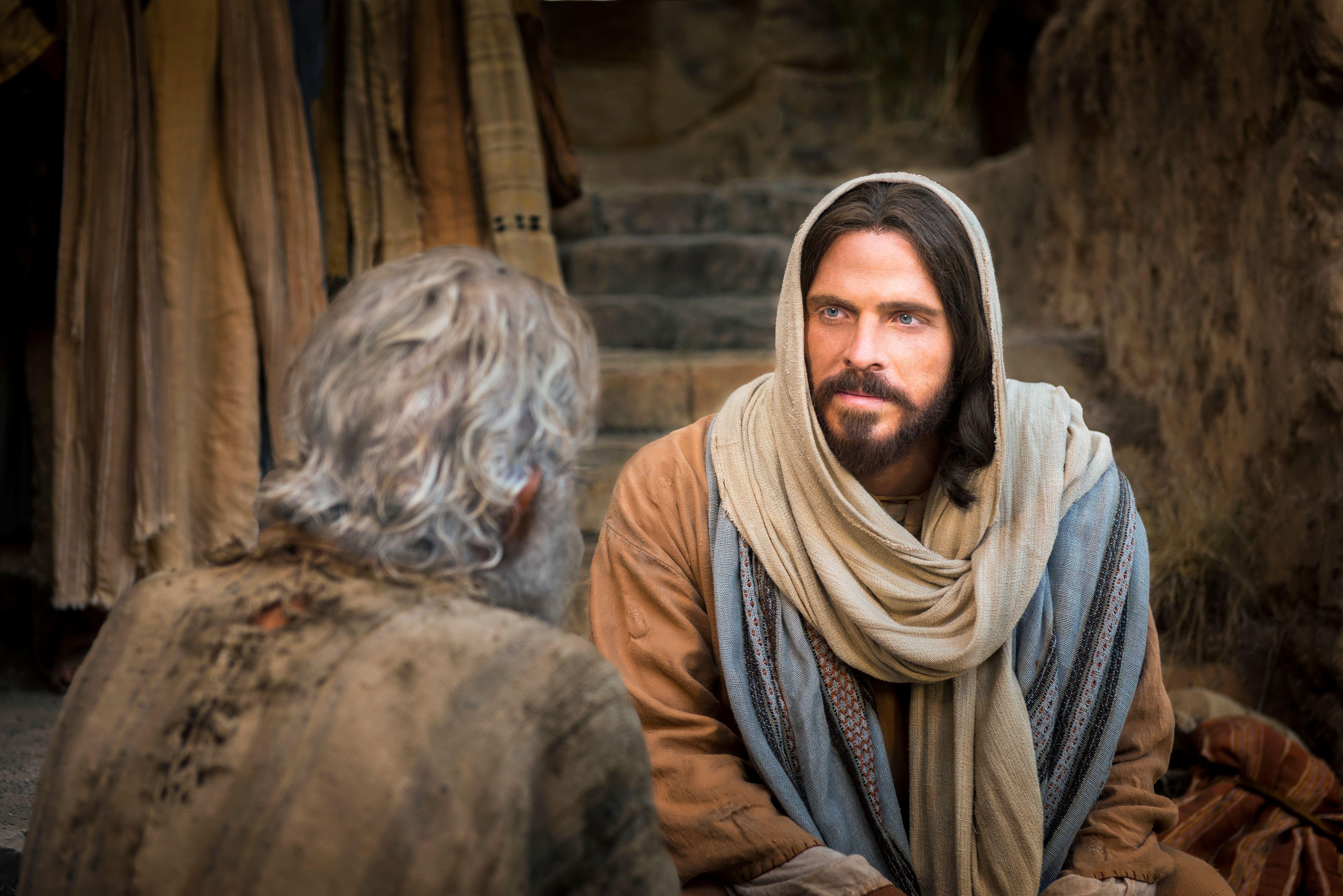 Christ sitting beside a man and healing him.
