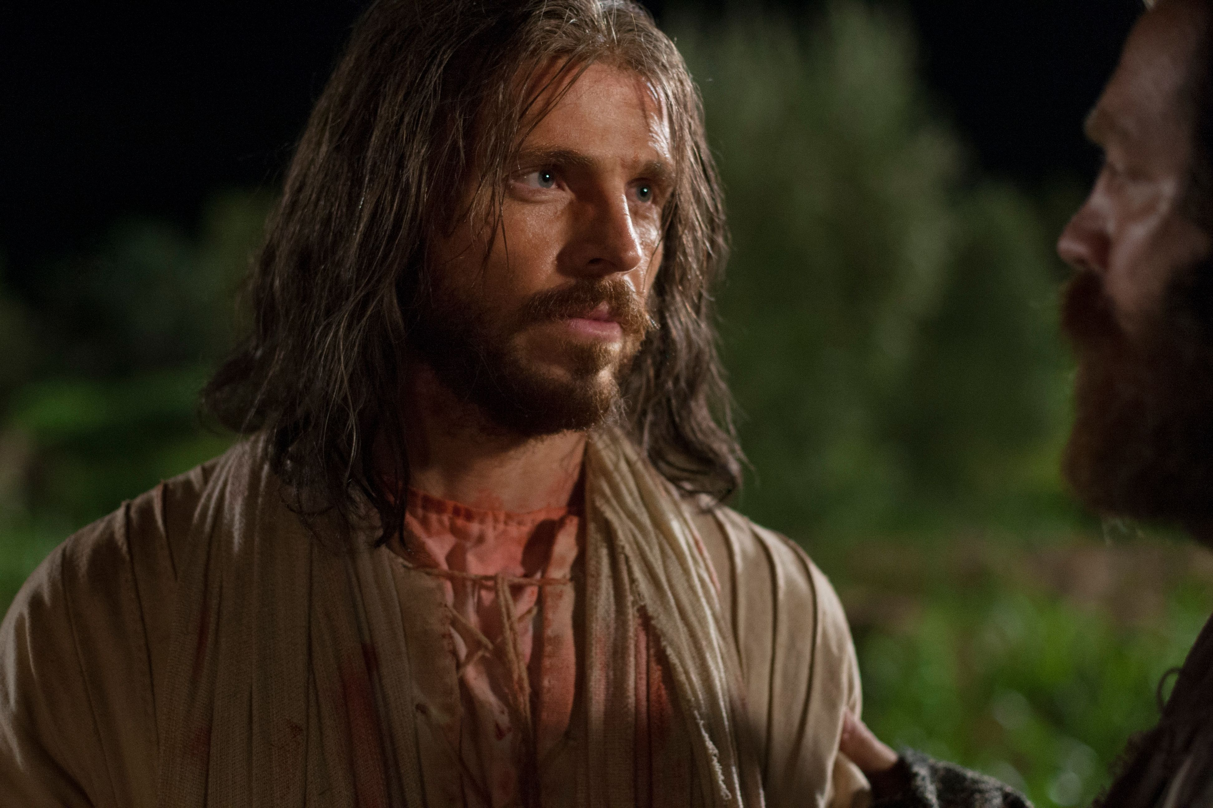 Jesus looks at Judas Iscariot after being betrayed.